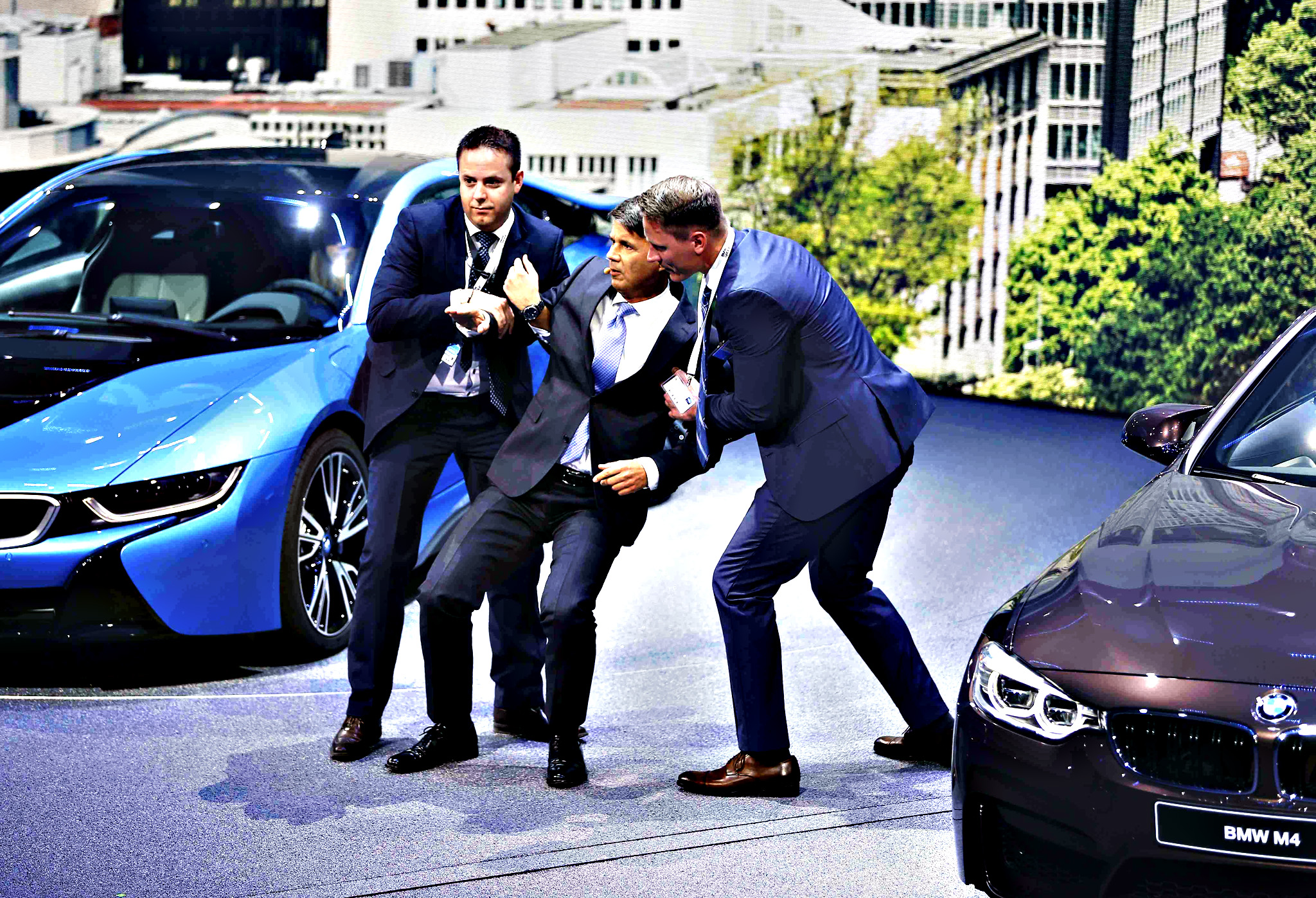 BMW CEO Krueger is helped after he collapsed at a presentation during the media day at the Frankfurt Motor Show (IAA) in Frankfurt...BMW CEO Harald Krueger (C) is helped after he collapsed at a presentation during the media day at the Frankfurt Motor Show (IAA) in Frankfurt, Germany, September 15, 2015.