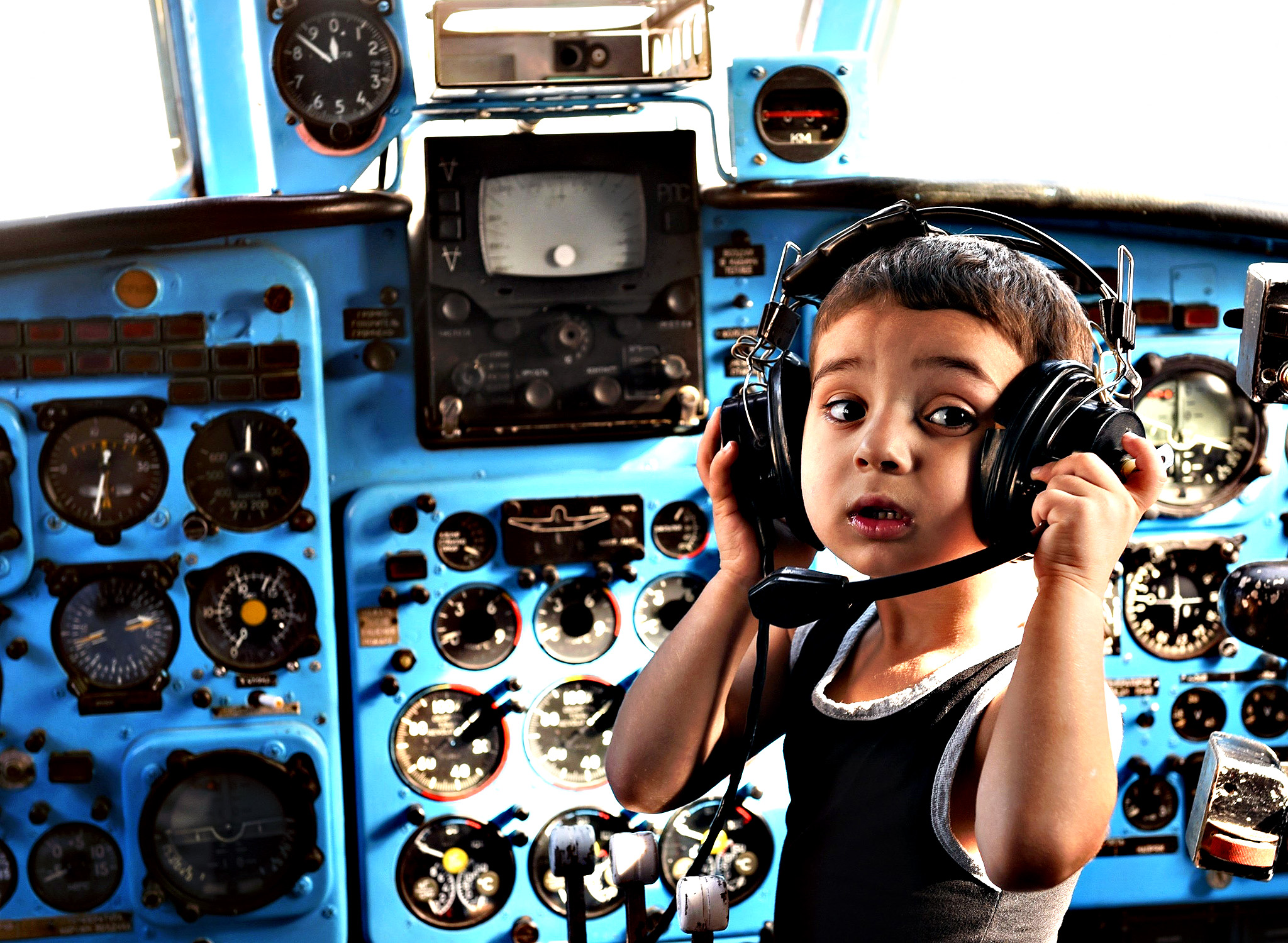 A boy plays inside a Soviet-era Yakovlev Yak-40 plane turned into their kindergarten in the Georgian city of Rustavi, some 25 km southeast of the capital Tbilisi, on Monday. Local head teacher Gari Chapidze bought the old but fully functional Yak-40 from Georgian Airways and refurbished its interior with educational equipment, games and toys but left the cockpit instruments intact so they could be used as play tools