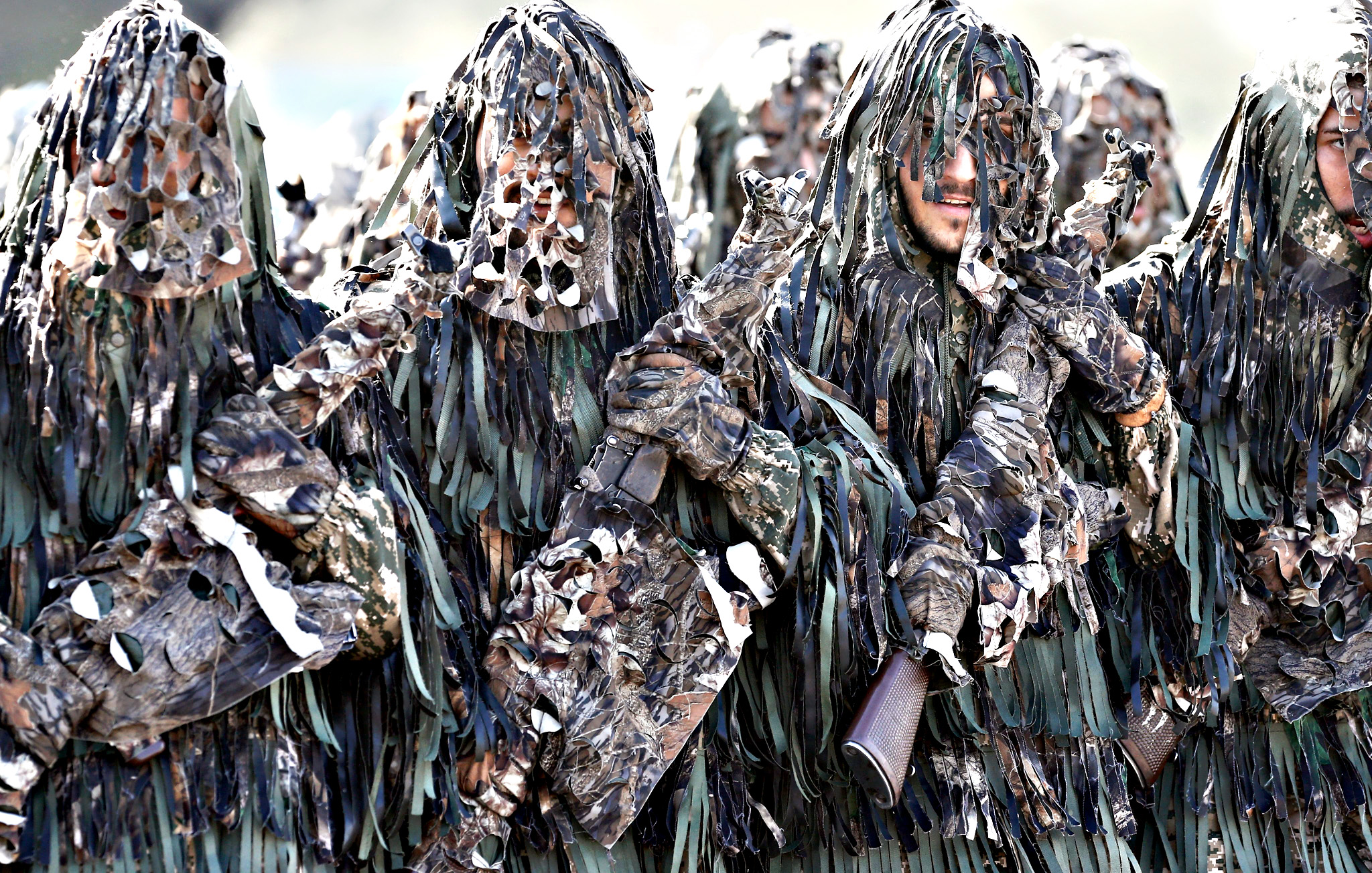 Camouflaged Iranian Army soldiers march during the annual military parade marking the begging of the 1980 war with Iraq, in Tehran, Iran, 22 September 2015. Iran is marking the start of the eight-year-long war with Iraq (1980-1988)