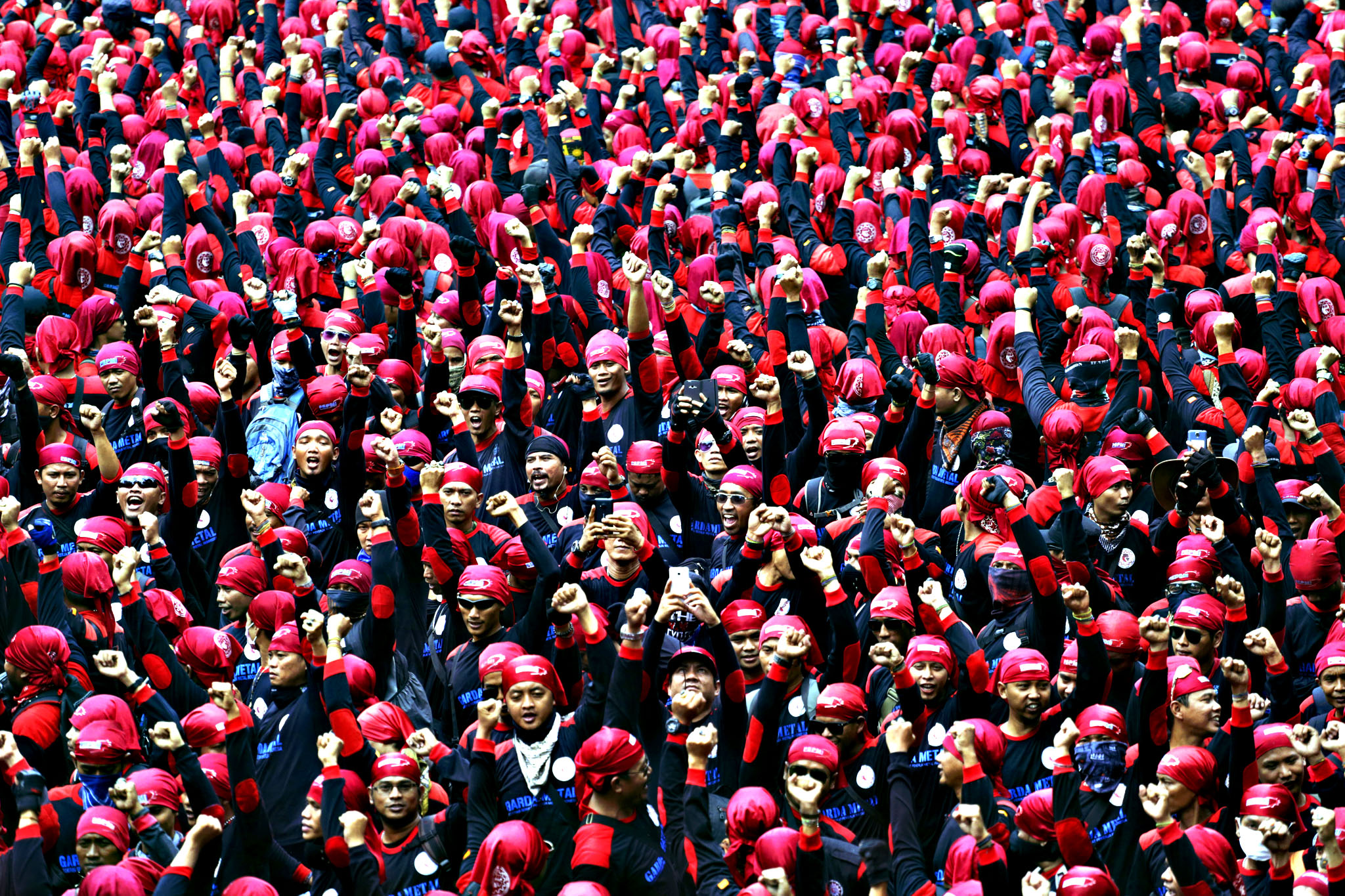 Indonesian workers shout slogans during a rally in Jakarta, Indonesia, Tuesday, Sept. 1, 2015. Thousands of factory workers staged the rally in the capital to protest against outsourcing and low wages