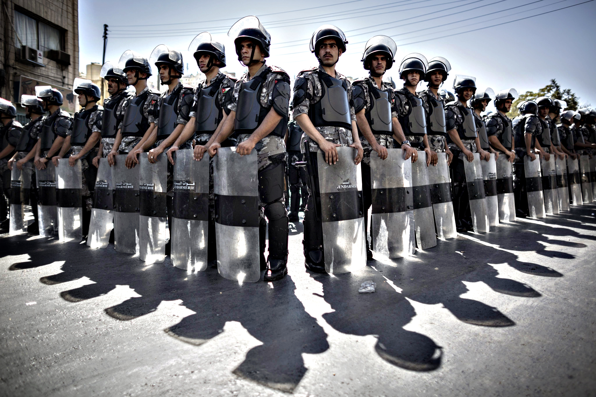 Jordanian riot policemen stand guard during a protest following the Friday prayers in Amman, Jordan, 18 September 2015. Several thousand people marched in solidarity with Palestinians who clashed with Israeli security forces around the Al-Aqsa Mosque, Islam's third holiest site, in Jerusalem for several consecutive days