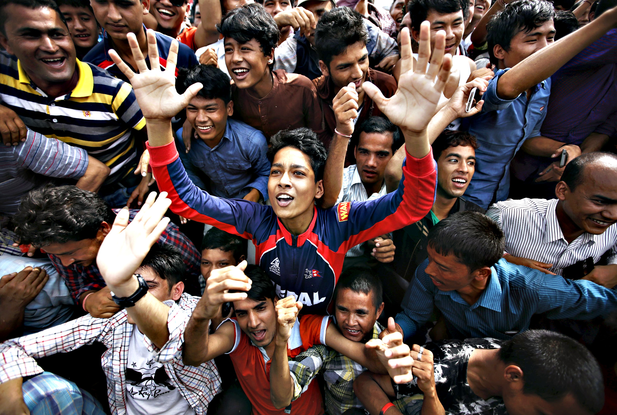 People cheer as they gather during a celebration a day after the first democratic constitution was announced in Kathmandu, Nepal September 21, 2015. Nepal adopted its first full democratic constitution on Sunday, a historic step for a nation that has witnessed war, a palace massacre and devastating earthquakes since a campaign to create a modern state began more than 65 years ago