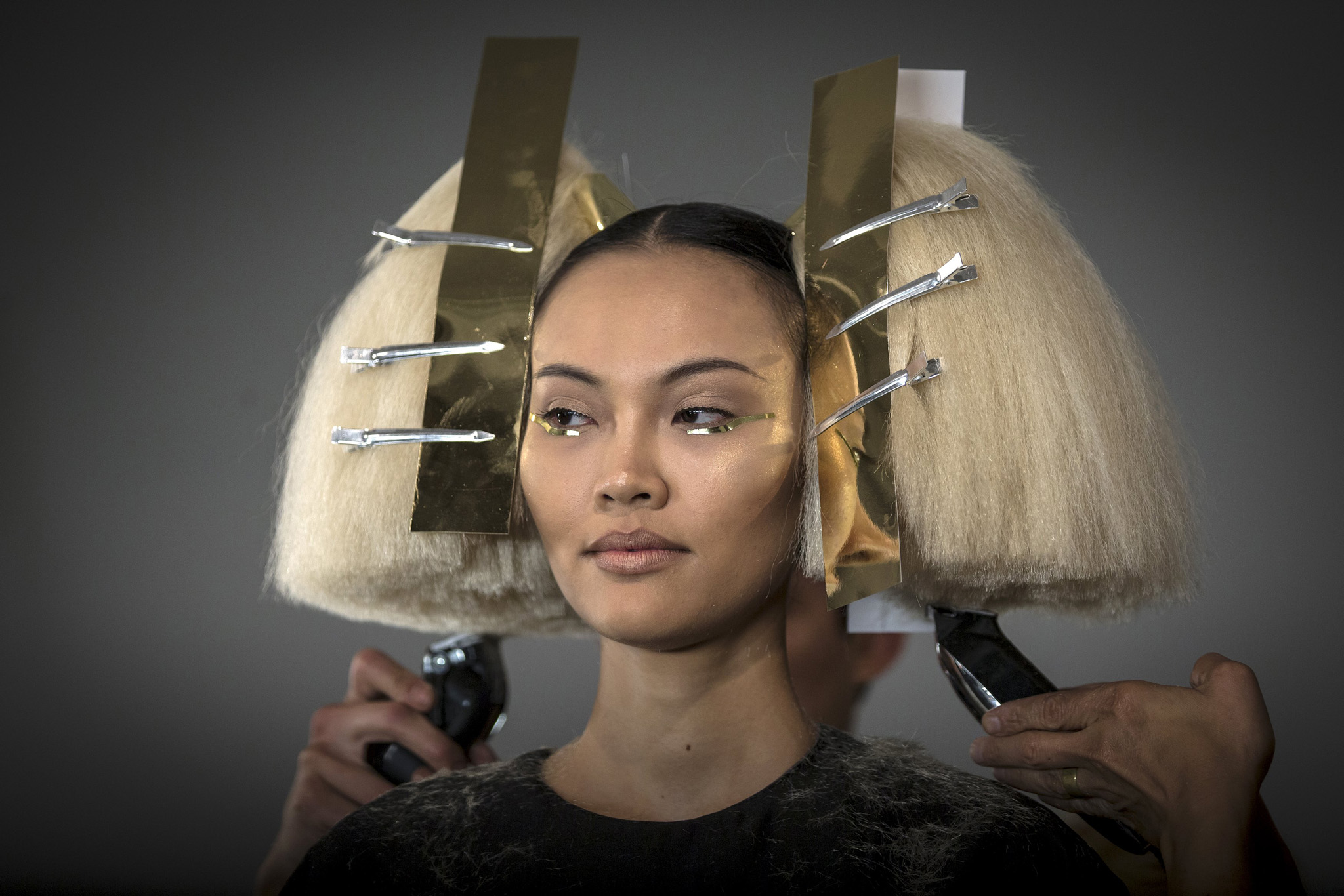 A model has her hair done before The Blonds Spring/Summer 2016 collection during New York Fashion Week in New York