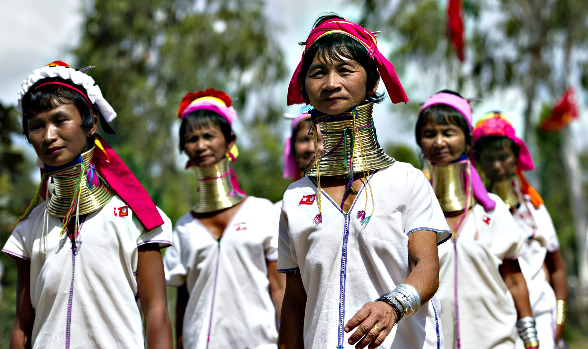 Kayan ethnic women wait for the arrival of National League for Democracy chairperson Aung San Suu Kyi during an election campaign rally in Demoso, Myanmar's Kayah State on Thursday