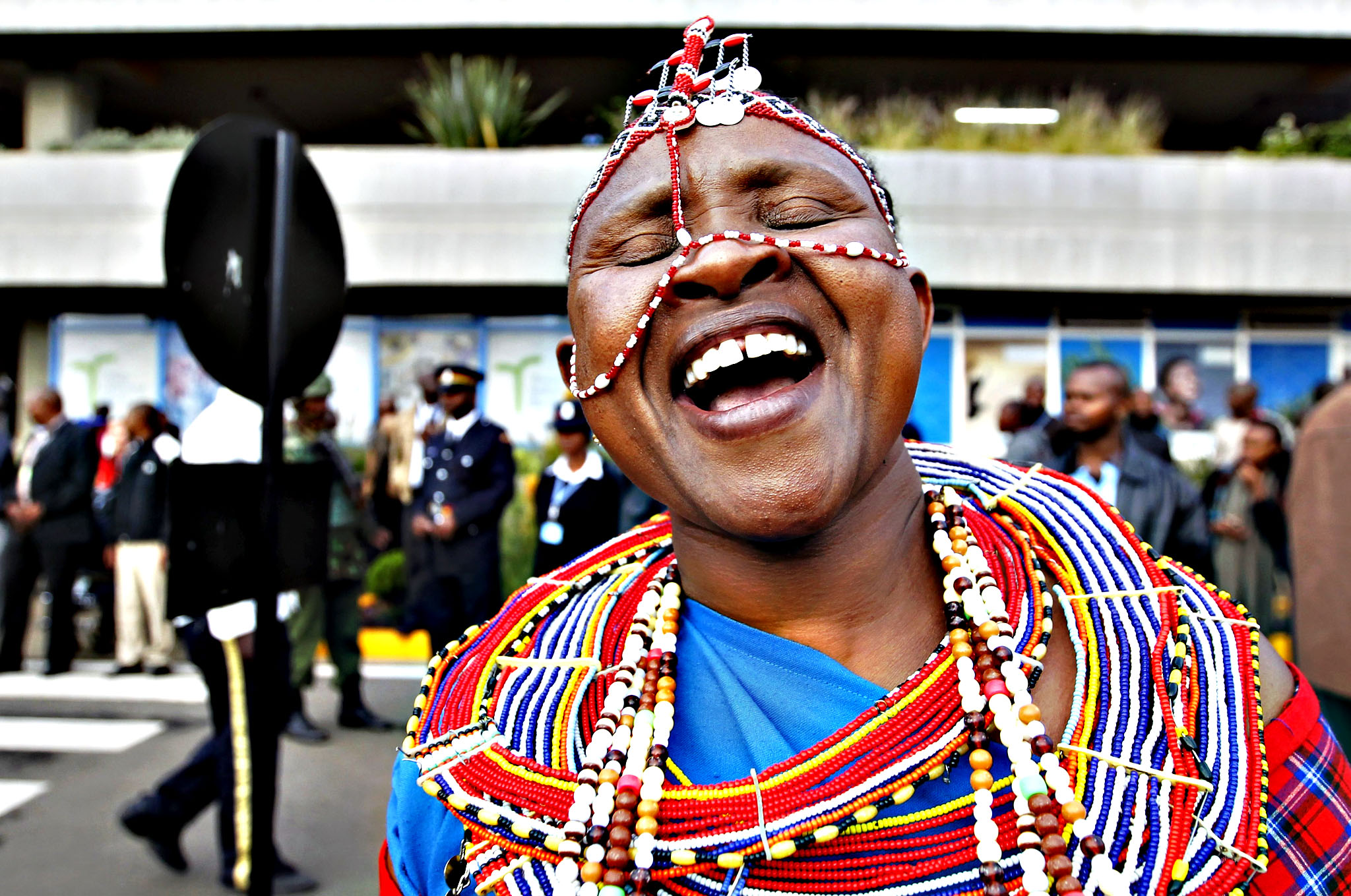 A Maasai woman in traditional clothing celebrates as she welcomes the national athletics team at the Jomo Kenyatta airport in Nairobi on Monday, after they topped the medals table at the recently concluded 15th International Association of Athletics Federations (IAAF) World Championships at the National Stadium in Beijing, China