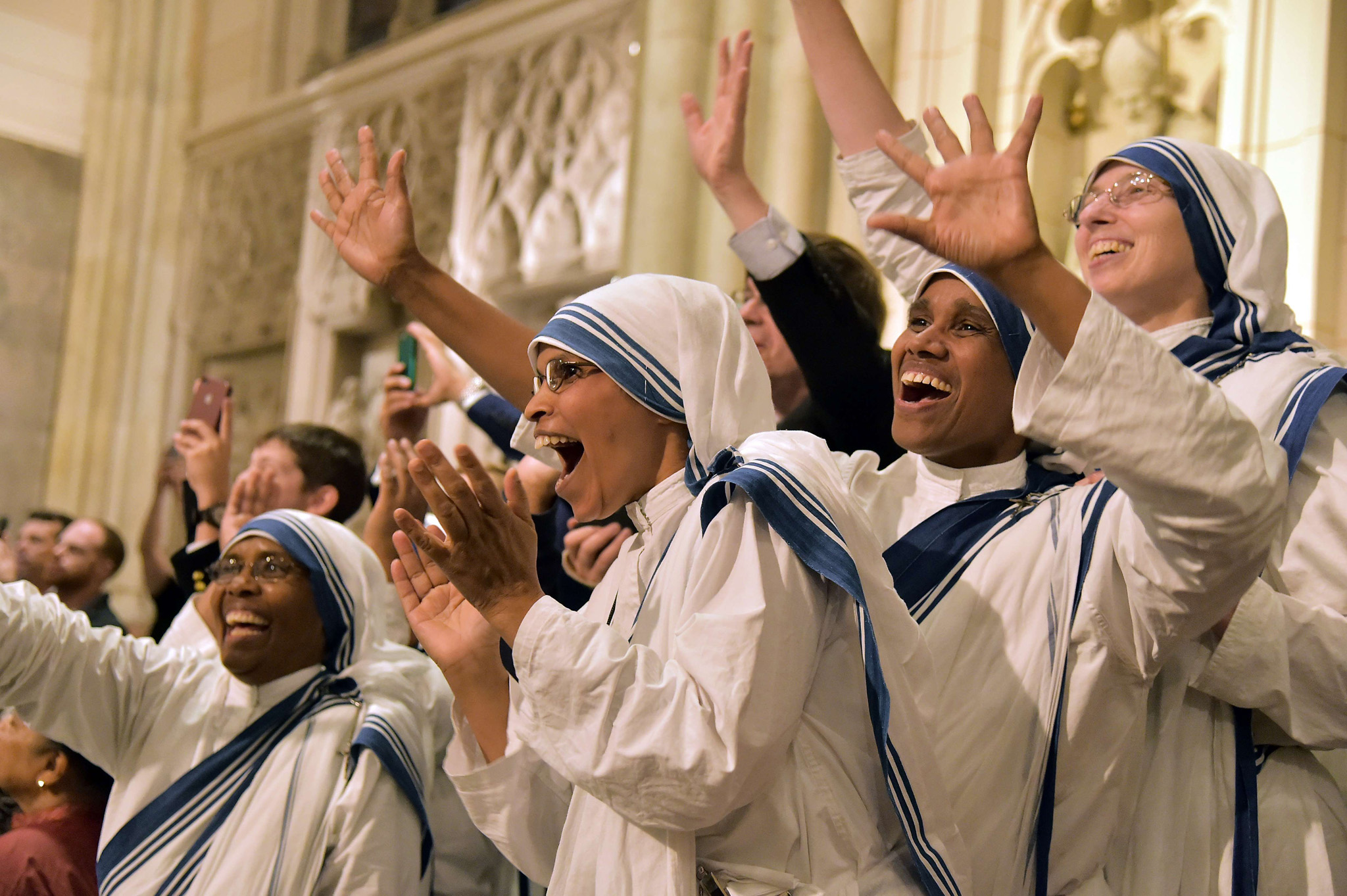 Nuns celebrate as they wait for the arrival of Pope Francis at St Patrick's Cathedral in New York yesterday