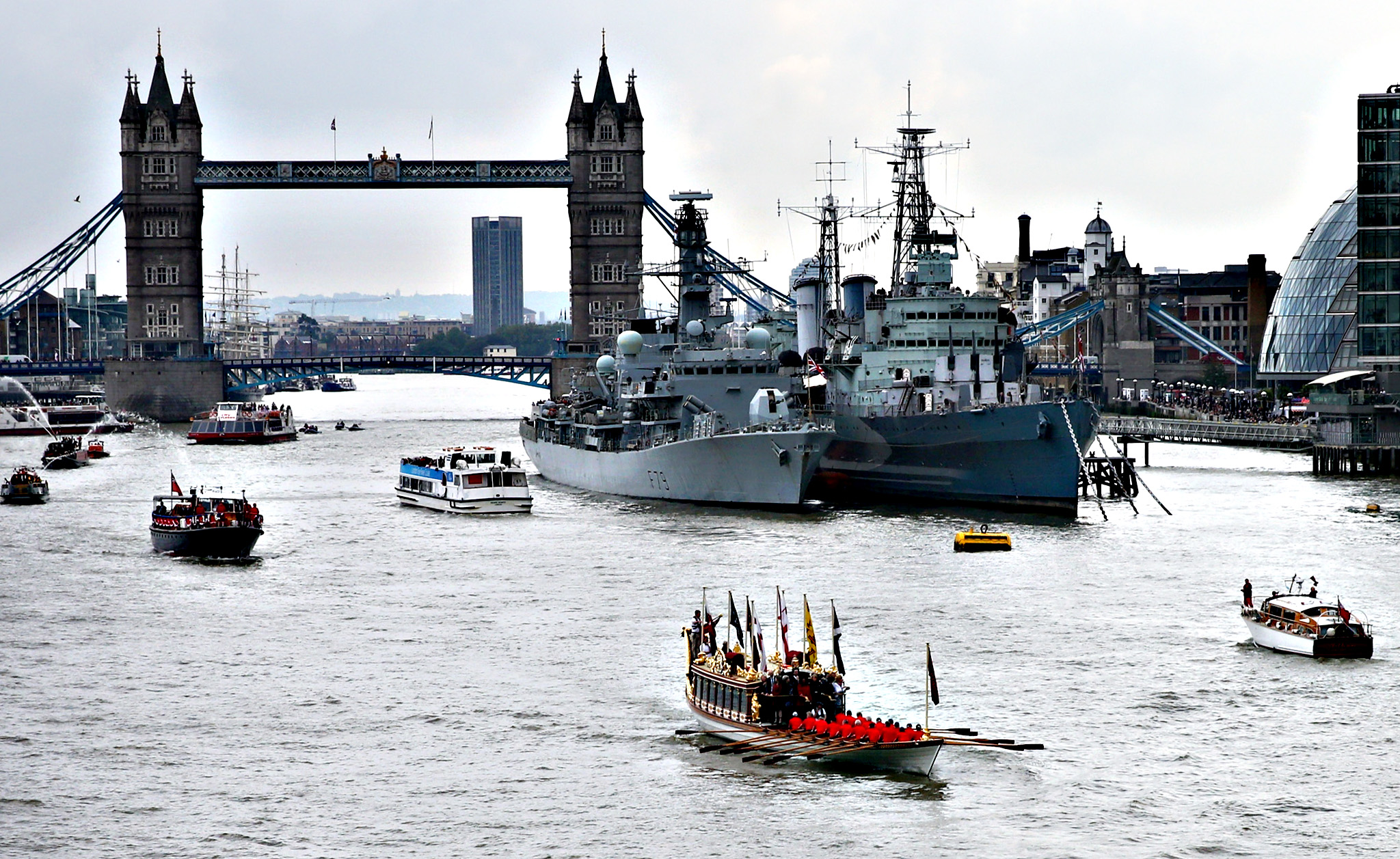 The Royal Barge Gloriana leads a procession along the River Thames near Tower Bridge and HMS Belfast to pay tribute to Queen Elizabeth II becoming Britain's longest reigning monarch on September 9, 2015 in London, England. The Queen will have served for 63 years and seven months - 23,226 days - by around 5.30pm today surpassing her great-grandmother Queen Victoria to become Britain's longest ever reigning monarch