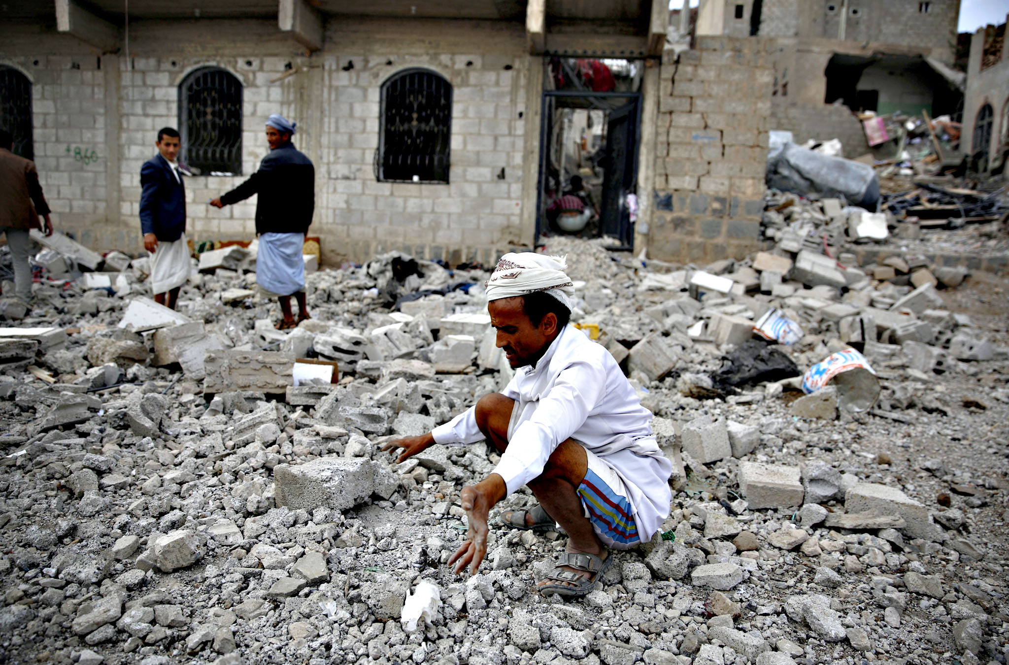 A man inspects on the rubble of a house destroyed by a Saudi-led airstrike in Sanaa, Yemen, Monday, Sept. 7, 2015.