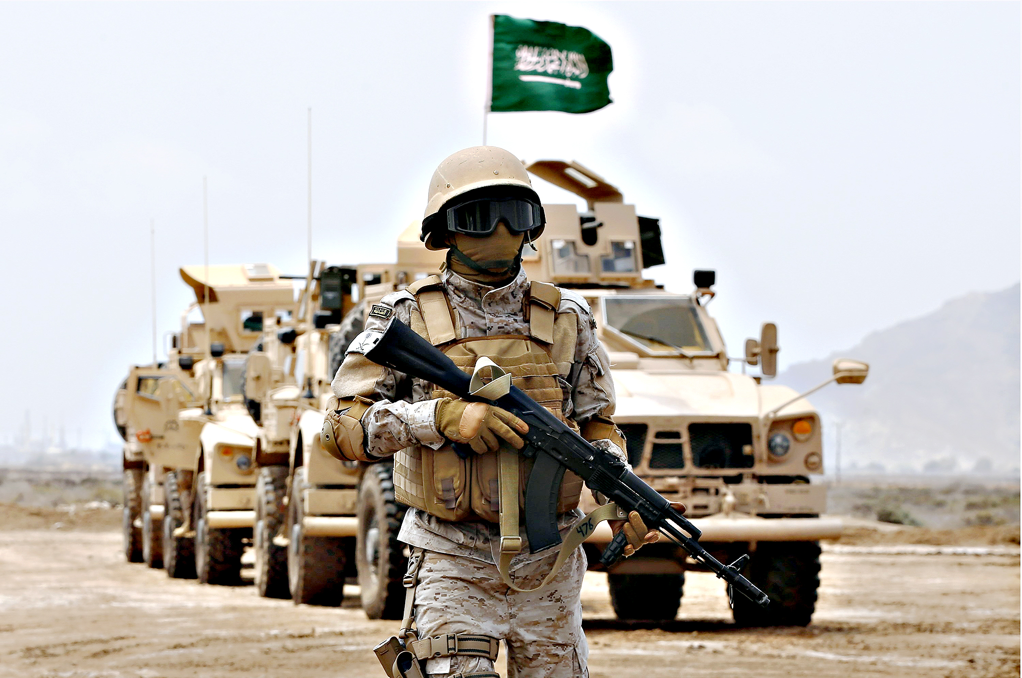 A member of the Saudi forces stands to attention during a visit by Yemeni Prime Minister Khaled Bahah at the Saudi-led coalition military base in Yemen's southern embattled city of Aden on Monday. Since Bahah's return from exile on September 16, 2015, his government is conducting the country's business from Aden, and is aiming to reinforce fighters supporting Yemeni President Abedrabbo Mansour Hadi, battling Shiite Huthi rebels in the central region