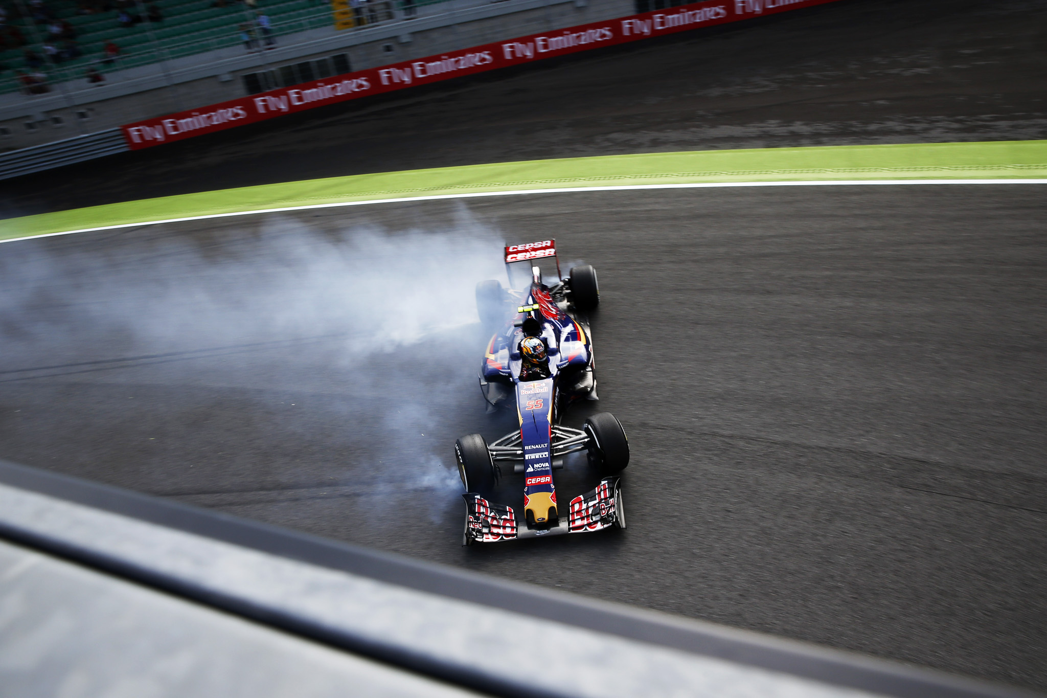 Toro Rosso driver Carlos Sainz Jr. of Spain goes off the track at the parabolic turn  during the first free practice at the Monza racetrack, in Monza, Italy , Friday, Sept. 4 , 2015. The Formula one race will be held on Sunday.