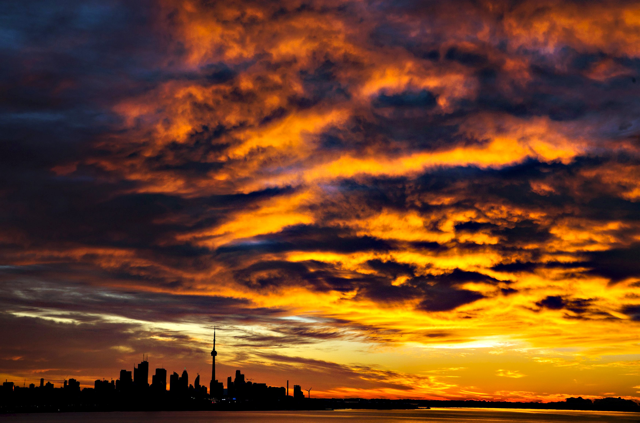 The sun begins to rise over the skyline in Toronto on Monday.