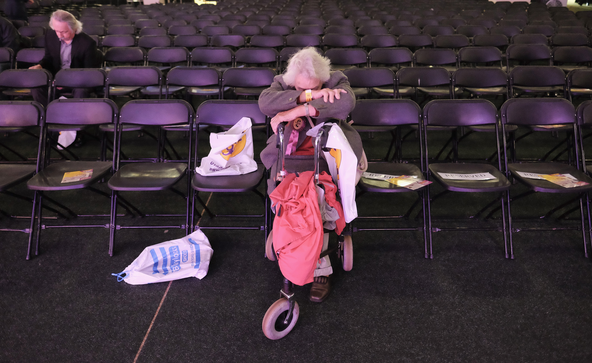 A woman rests as she waits for the conference to start ahead of the UK Independence Party annual conference