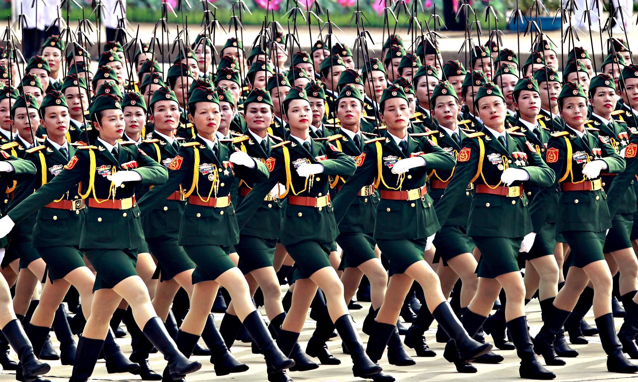 Vietnamese female commissioned officers of the signal force march during a parade marking their 70th National Day at Ba Dinh square in Hanoi, Vietnam...Vietnamese female commissioned officers of the signal force march during a parade marking their 70th National Day at Ba Dinh square in Hanoi, Vietnam September 2, 2015