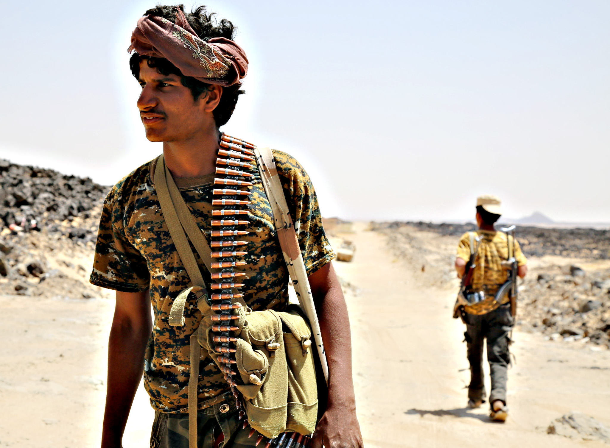 An armed Yemeni man from the Popular Resistance Committees, supporting forces loyal to Yemen's Saudi-backed fugitive President Abedrabbo Mansour Hadi, monitors the area in Marib province, east of the capital, Sanaa, on September 14, 2015. Hadi loyalists launched the largest and fiercest offensive since operations began in Marib province that is mostly controlled by fighters and armed tribes allied to Hadi, but the rebels and renegade troops loyal to ousted president Ali Abdullah Saleh still hold parts of the province
