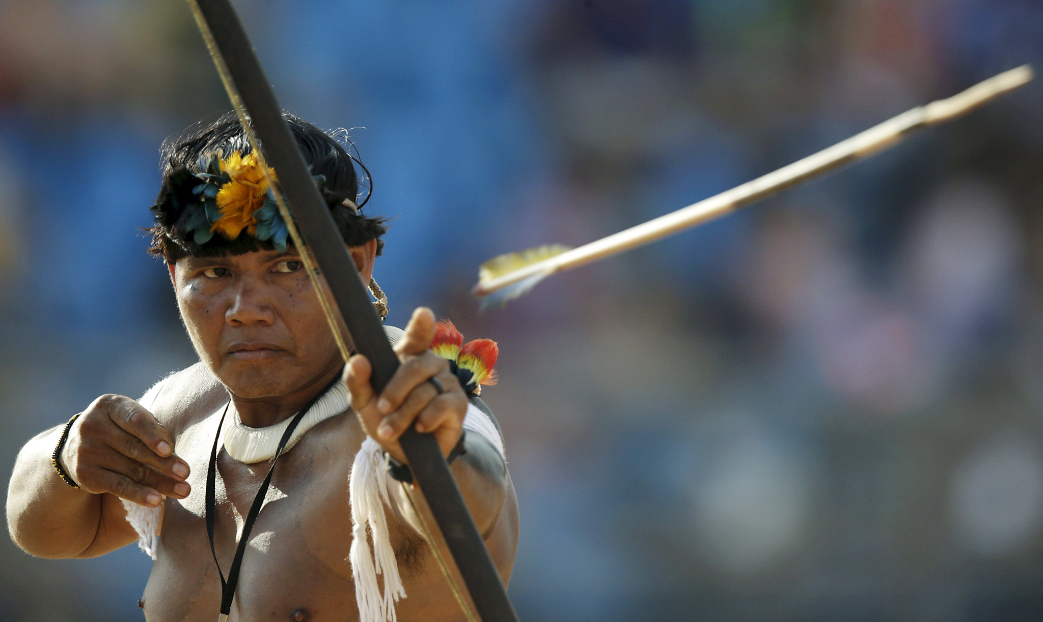 An indigenous man from Kuikuru fires an arrow during the bow-and-arrow competition at the first World Games for Indigenous Peoples in Palmas...An indigenous man from Kuikuru fires an arrow during the bow-and-arrow competition at the first World Games for Indigenous Peoples in Palmas, Brazil, October 28, 2015. REUTERS/Ueslei Marcelino