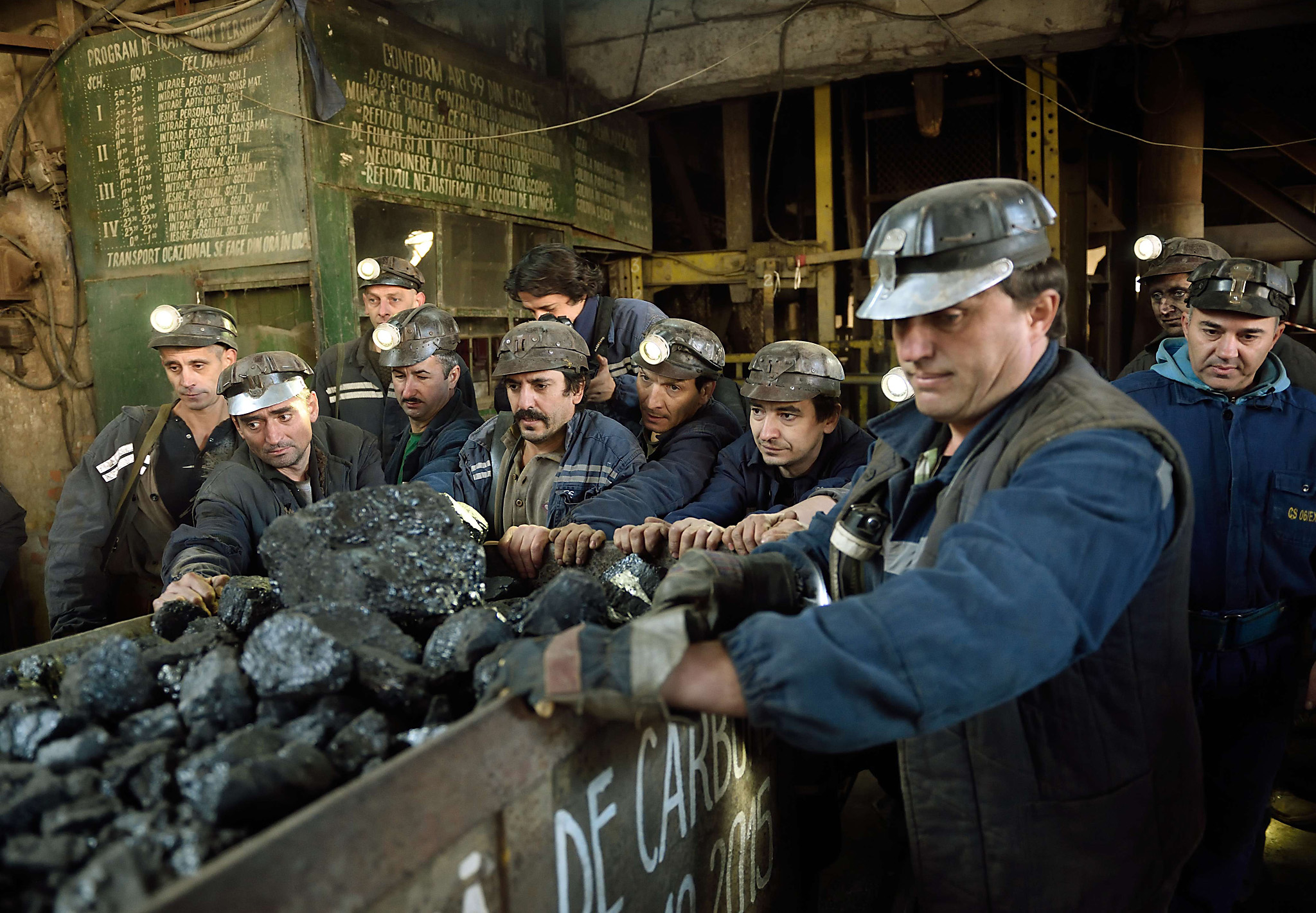 Miners push the last coal loaded mining ...Miners push the last coal loaded mining carriage at the end of their last shift at the coal mine in the Romanian city of Petrila, on October 30, 2015. Petrila, the oldest coal mine in Romania and deepest mine in Europe, that opened in 1859 under the Austro-Hungarian Empire, was closed on October 30, 2015 as part of Bucharest promises to liquidate unprofitable mines.  AFP PHOTO / DANIEL MIHAILESCUDANIEL MIHAILESCU/AFP/Getty Images