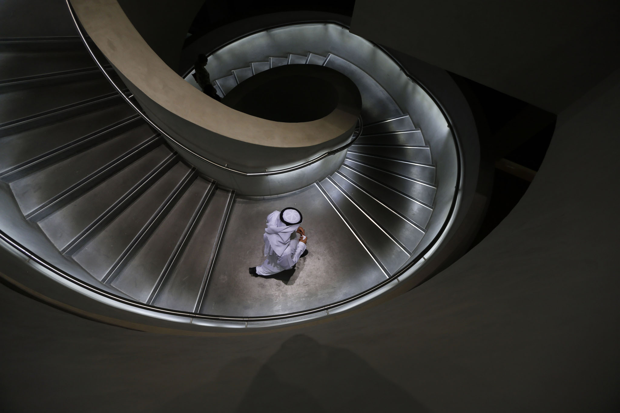 An Emirati man walks down stairs in Masdar City
