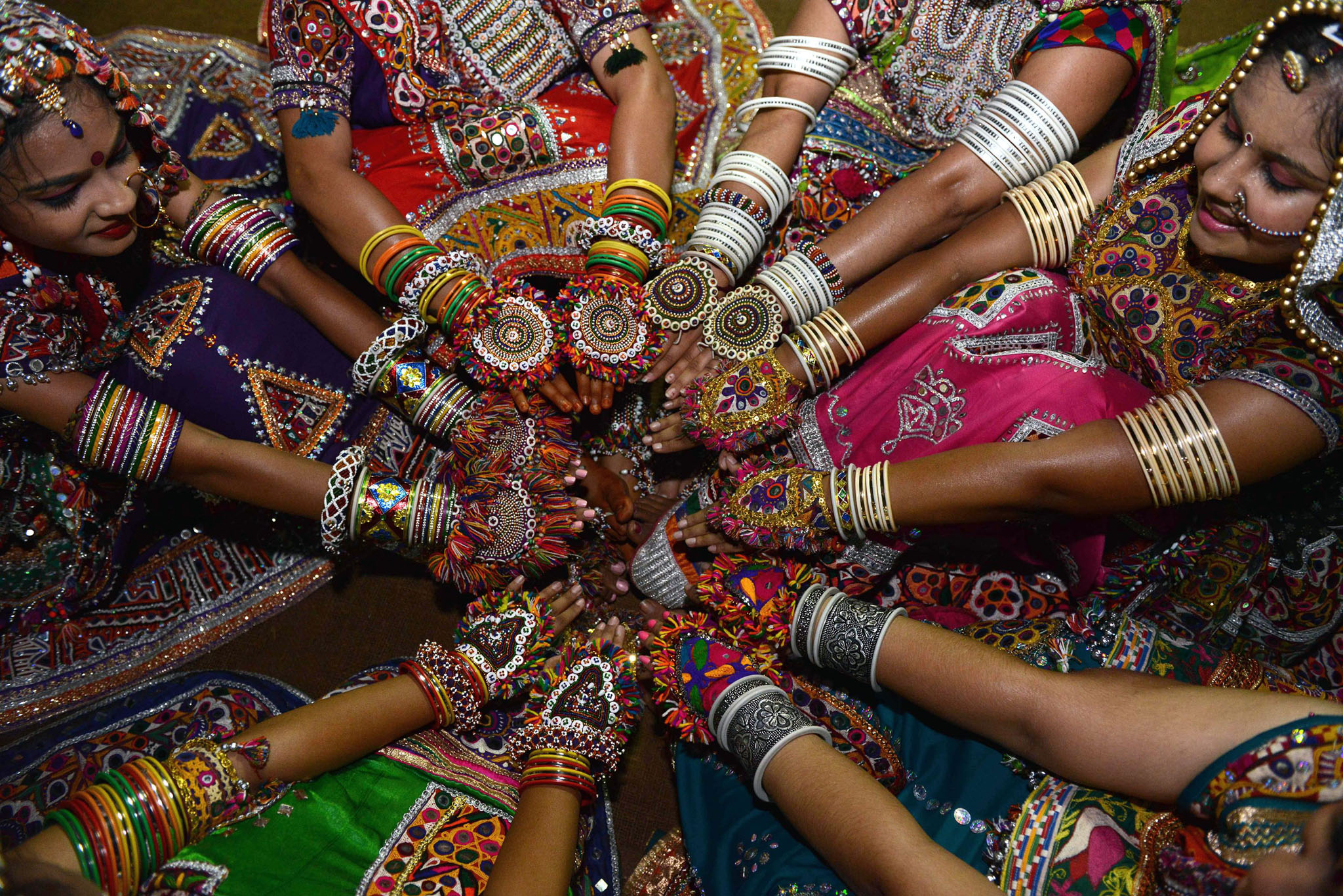ndian folk dancers display ornaments during a break while participating in the first night of Navratri