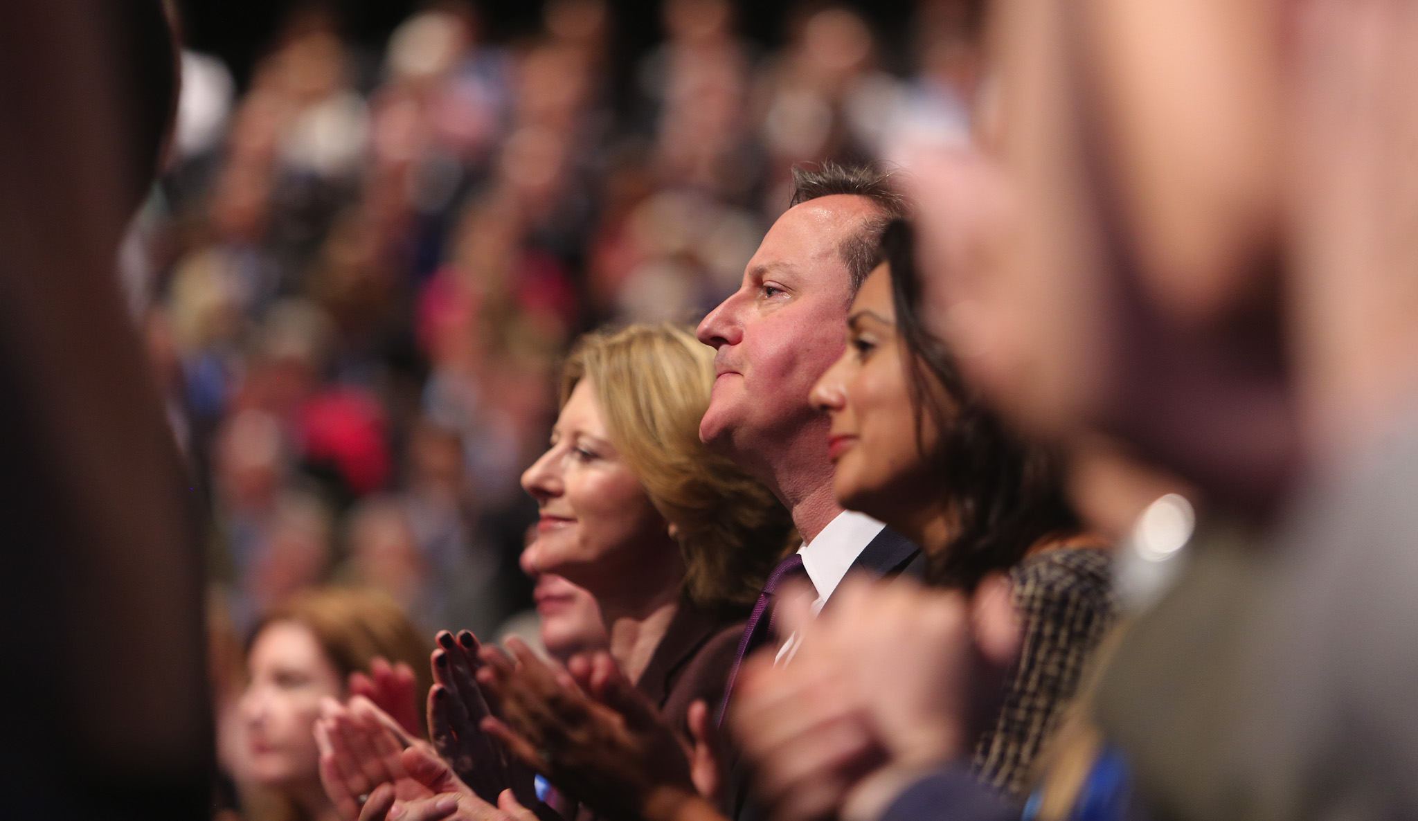British Prime minister David Cameron listens as the Chancellor of the Exchequer, George Osborne, delivered his keynote speech at the Conservative Party conference in Manchester.