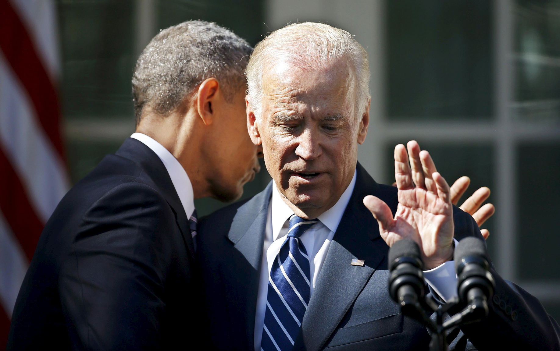 U.S. President Obama hugs Vice President Biden after Biden announced he will not seek the 2016 Democratic presidential nomination during an appearance at the White House in Washington