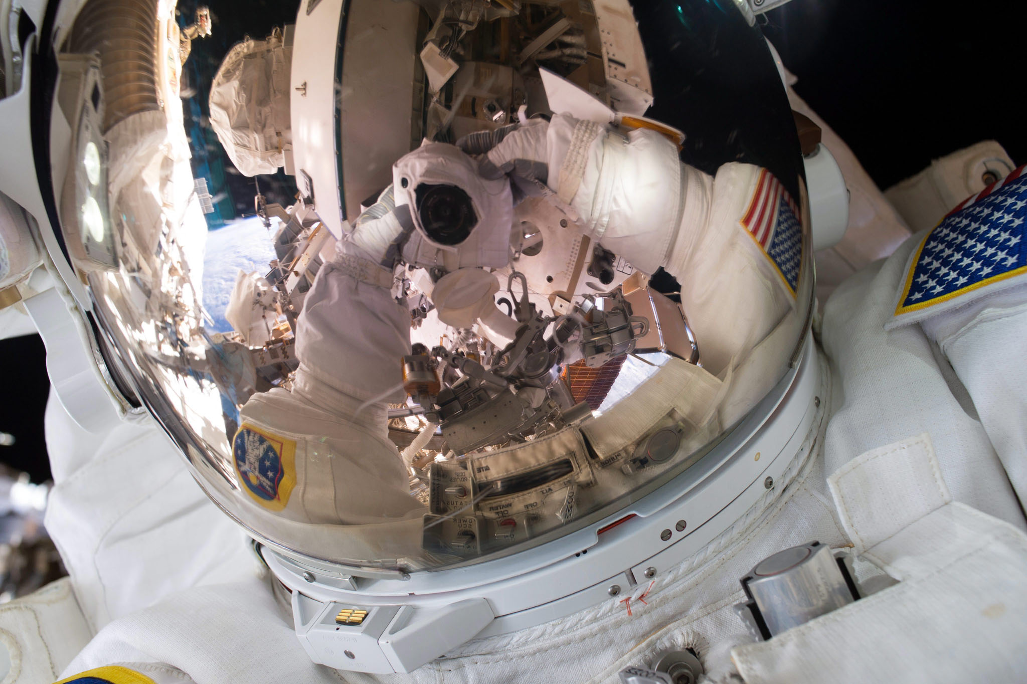 Expedition 45 Commander Scott Kelly's spacewalk selfie...epa05003126 A handout picture released 30 October 2015 and dated 28 October 2015, provided by NASA, shows Expedition 45 Commander Scott Kelly during a spacewalk. Sharing the image on social media, Kelly wrote, '#SpaceWalkSelfie Back on the grid! Great first spacewalk yesterday. Now on to the next one next week. #YearInSpace'. According to NASA, this was the first spacewalk for both Kelly and Flight Engineer Kjell Lindgren; the two will venture outside the International Space Station for the second time on 06 November 2015.  EPA/NASA / SCOTT KELLY / HANDOUT  HANDOUT EDITORIAL USE ONLY