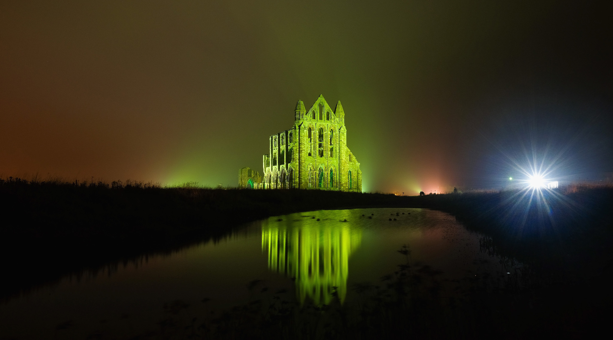 Whitby Abbey Seen In A New Light As Its Bathed In Dramatic Illuminations...WHITBY, ENGLAND - OCTOBER 27: A spectacular light display illuminates the historic Whitby Abbey on October 27, 2015 in Whitby, England. The famous Benedictine abbey will be illuminated over four nights to coincide with Halloween and the popular Whitby Goth Weekend. The Abbey was part of the inspiration for Bram Stoker's novel, Dracula, and sits on East Cliff in the town in a commanding position overlooking the North Sea. (Photo by Ian Forsyth/Getty Images)