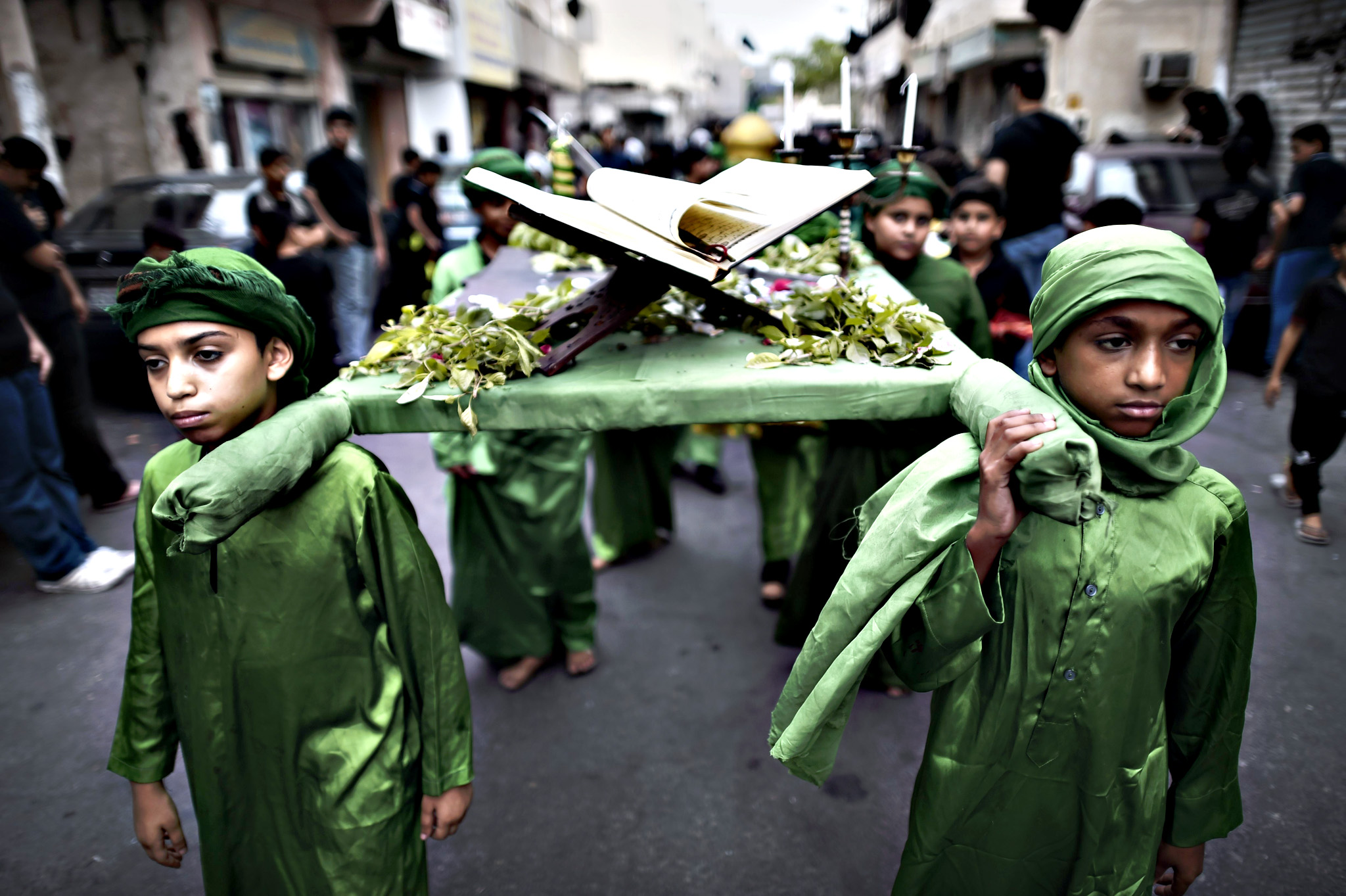 Bahraini Shia Muslims take part in a ceremony commemorating Ashura, which marks the seventh century slaying of Imam Hussein, the grandson of Prophet Mohammed and one of Shia Islam's most revered figures, in the village of Sanabis, west of Manama, on October 22, 2015.