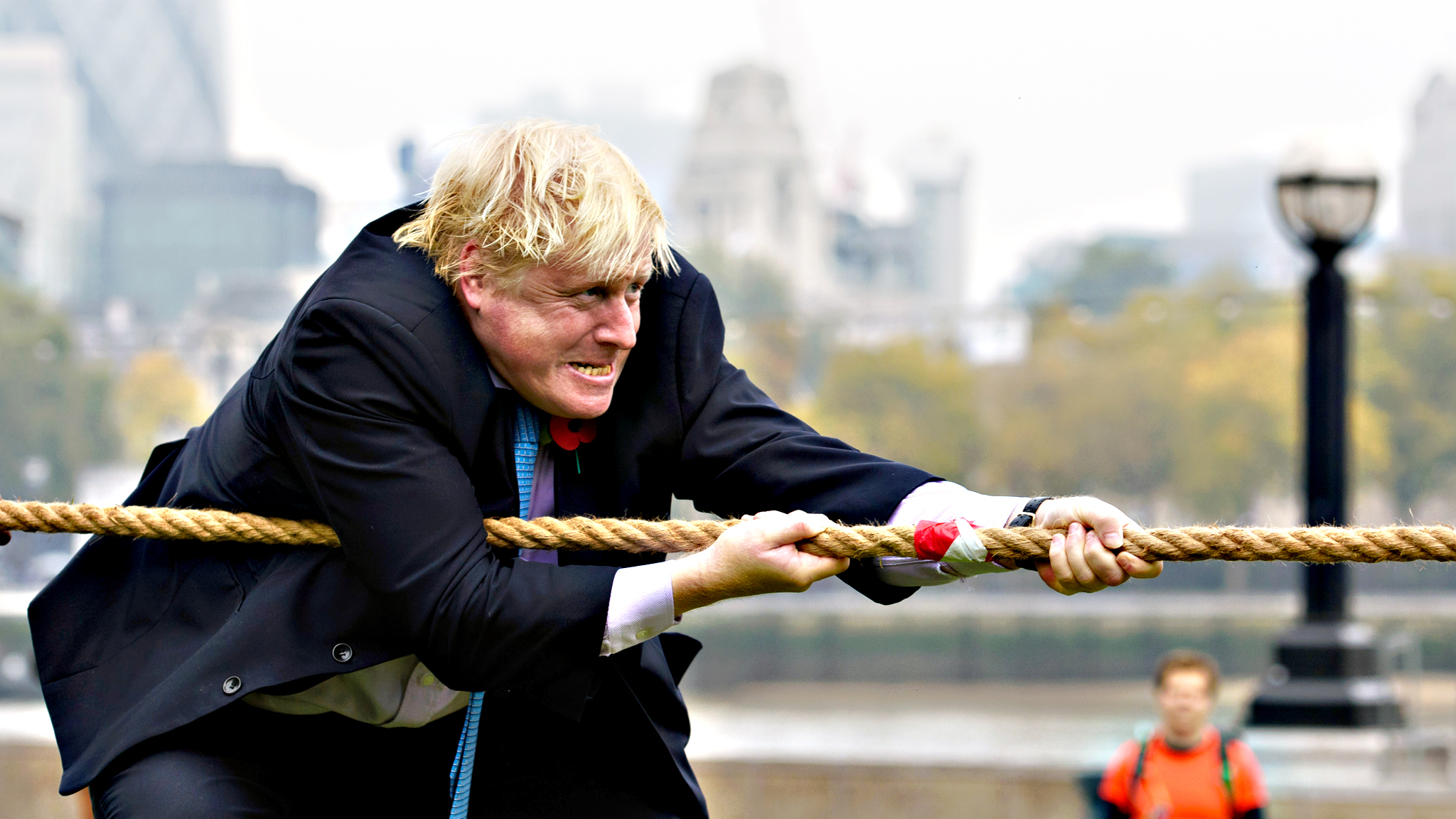 "Mayor of London, Boris Johnson competes in a tug of war during the launch of London Poppy Day on Tuesday in London, England. Poppies have been used to commemorate soldiers who have died in conflict since 1914 and are distributed by the British Royal Legion in the UK in return for donactions to the ""Poppy Appeal"""