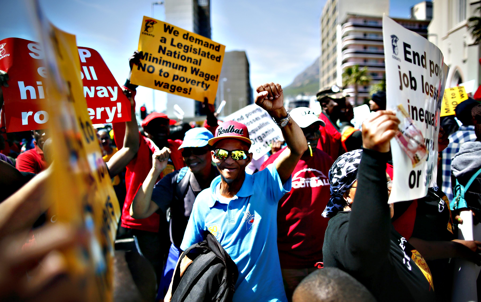 COSATU march to parliament...epa04967149 Protesters chant slogans and sing during a Congress of South African Trade Unions (COSATU) protest outside parliament in Cape Town, South Africa, 07 October 2015. Members of COSATU nationwide have embarked on a national strike. COSATU Provincial secretary Tony Ehrenreich said the march aimed to put pressure on the government to halt retrenchments, immediate implementation of an efficient and reliable public transport system and for aboloshing e-tolls