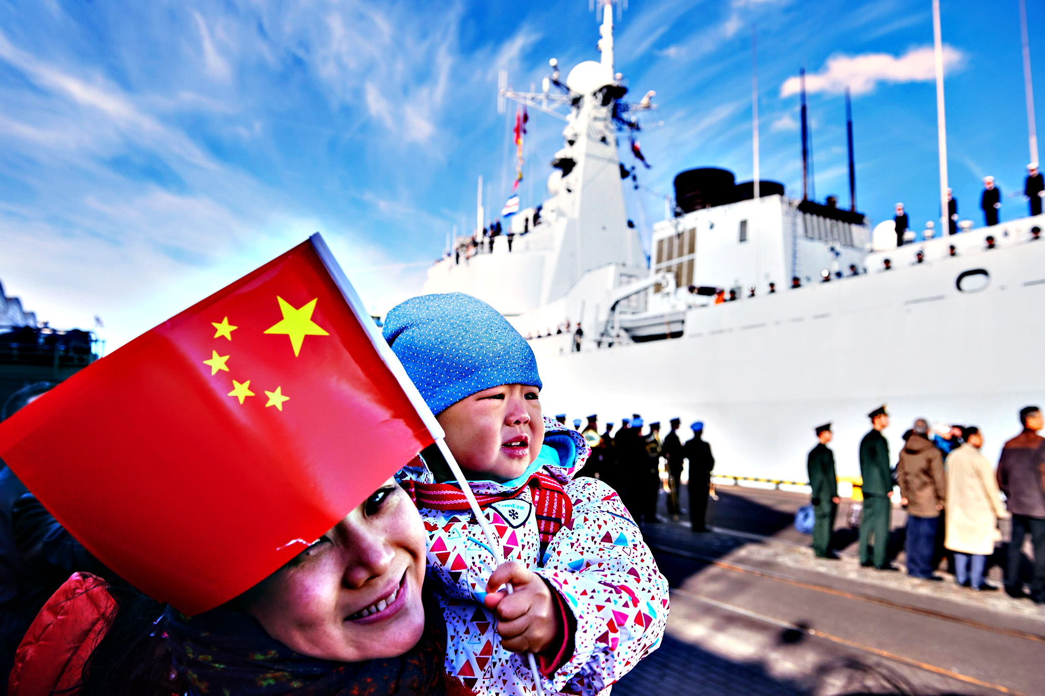 Chinese people living in Poland wait for Chinese Navy ships in the port of Gdynia in Gdynia, Poland, 07 October 2015. Three Chinese naval vessels, a destroyer 'Jinan', a multi-role frigate 'Yiyang' and replenishment ship 'Qiandaohu', came to Gdynia for the Chinese Navy's first-ever visit to Poland. The ships are part of a task force which recently completed an anti-piracy mission in the Gulf of Aden. The ships are currently on a five-month tour of seaports worldwide and have already visited Sudan, Egypt, Denmark, Finland and Sweden. The visit to Poland is aimed at developing friendly relations and exchange between China and Poland
