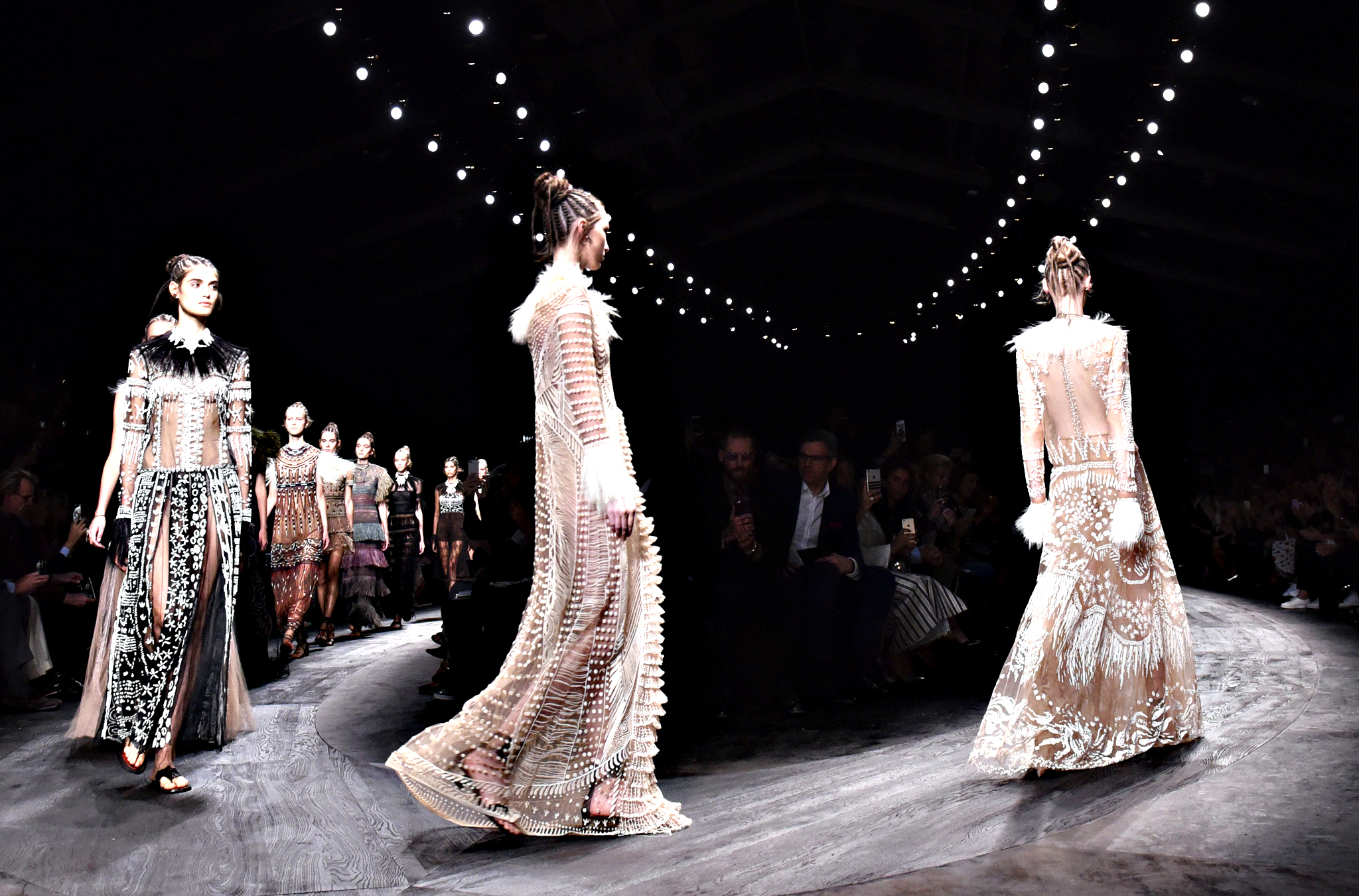 Models wear creations for Valentino's Spring-Summer 2016 ready-to-wear fashion collection presented during the Paris Fashion Week, in Paris, France, Tuesday, Oct. 6, 2015.