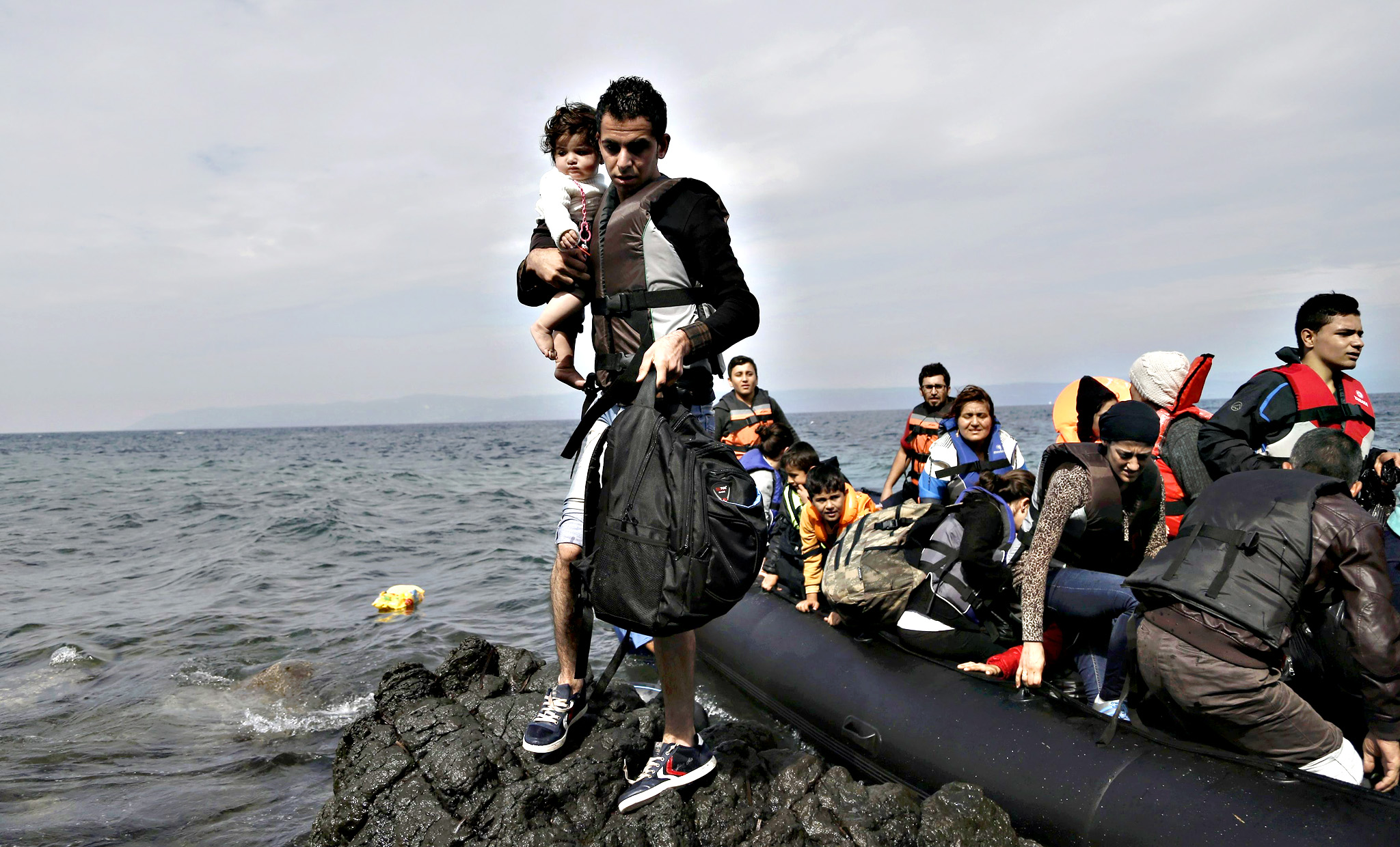 Refugees and migrants arrive at the island of Lesbos after crossing the Aegean see from Turkey, Greece, 08 October 2015