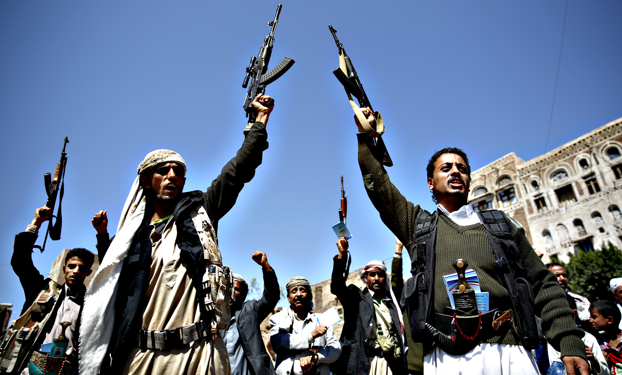Shiite fighters, known as Houthis, holding their weapons chant slogans during a tribal gathering showing support to the Houthi movement in Sanaa, Yemen, Thursday, Oct. 22, 2015