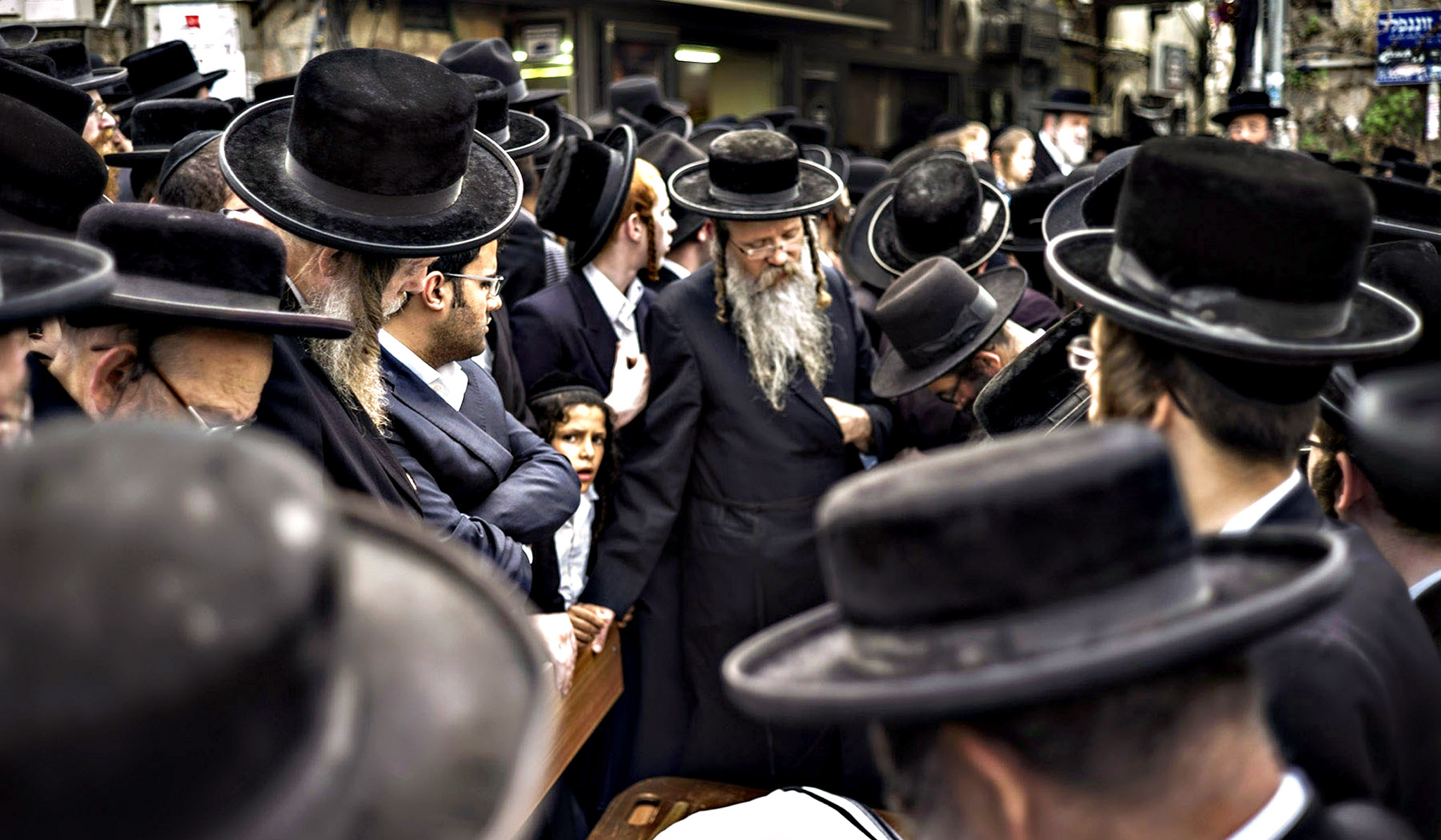 Ultra orthodox relatives and friends attend the funeral of Isheayahu Krishevsky on Tuesday in Jerusalem, Israel. Krishevsky was stabbed to death by a Palestinian man earlier today