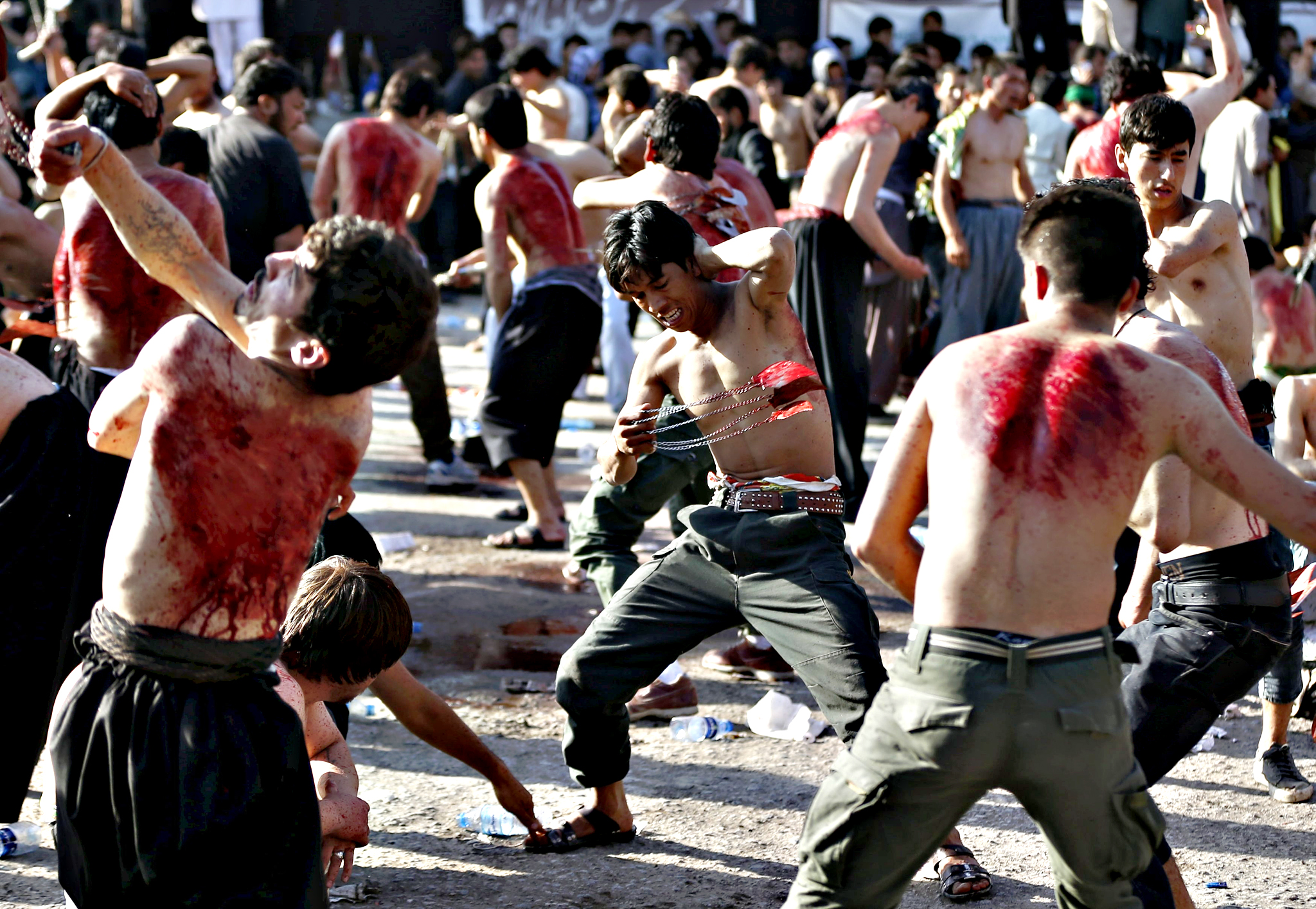 Afghan Shia Muslims flagellate themselves during an Ashura procession in Kabul, Afghanistan on Tuesday