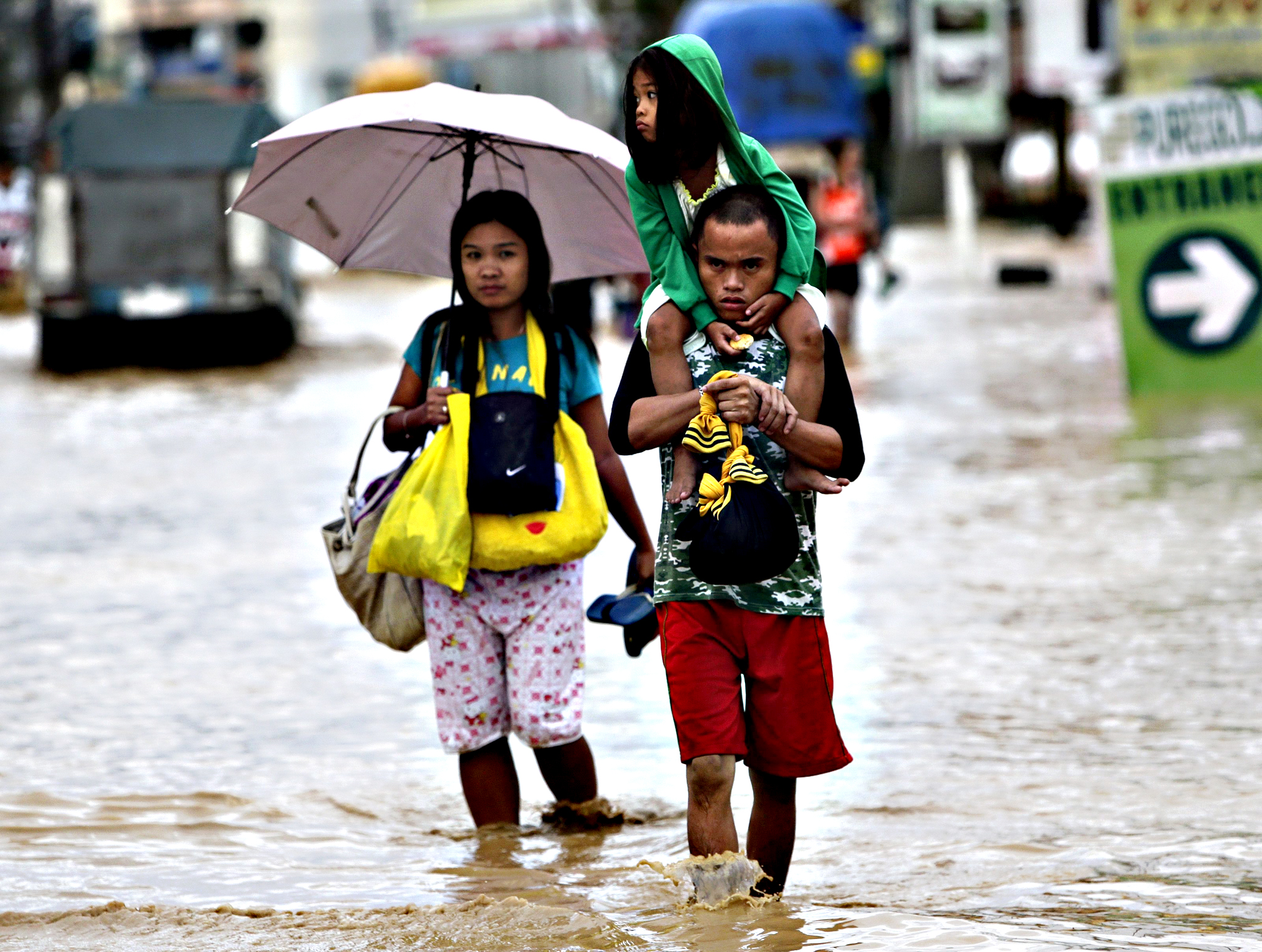 Filipino typhoon victims ride on a makeshift raft  at a flooded street in Cabanatuan city, northern Manila, Philippines, 19 October 2015. Typhoon Koppu triggered flash floods and landslides in the northern Philippines killing at least four people and forcing thousands of people to flee their homes, officials said. Two people drowned in the province of Nueva Ecija, according to Governor Aurelio Umali, while one person was electrocuted in Tarlac province and a 14-year-old boy was hit by a falling tree in Manila, disaster relief officials said. The Philippines is hit by an average of 20 cyclones every year, causing floods, landslides and other accidents. The strongest typhoon - Haiyan - hit the country in November 2013, killing more than 6,300 people. Haiyan also displaced more than four million people after it wiped out entire villages in the central Philippines