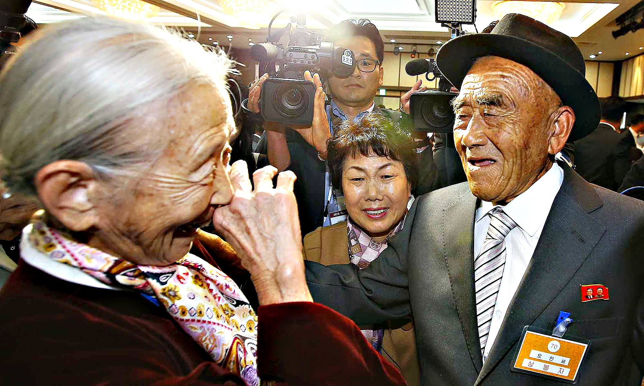 South Korean Lee Sun-Gyu, 85, smiles with her North Korean husband Oh In-Se, 83, during a separated family reunion meeting at the Mount Kumgang resort on the North's southeastern coast onTuesday. Nearly 400 mostly elderly South Koreans, carrying gifts of warm clothes, cash and cosmetics, crossed into North Korea for a rare meeting with relatives they have either never met or last saw more than six decades ago