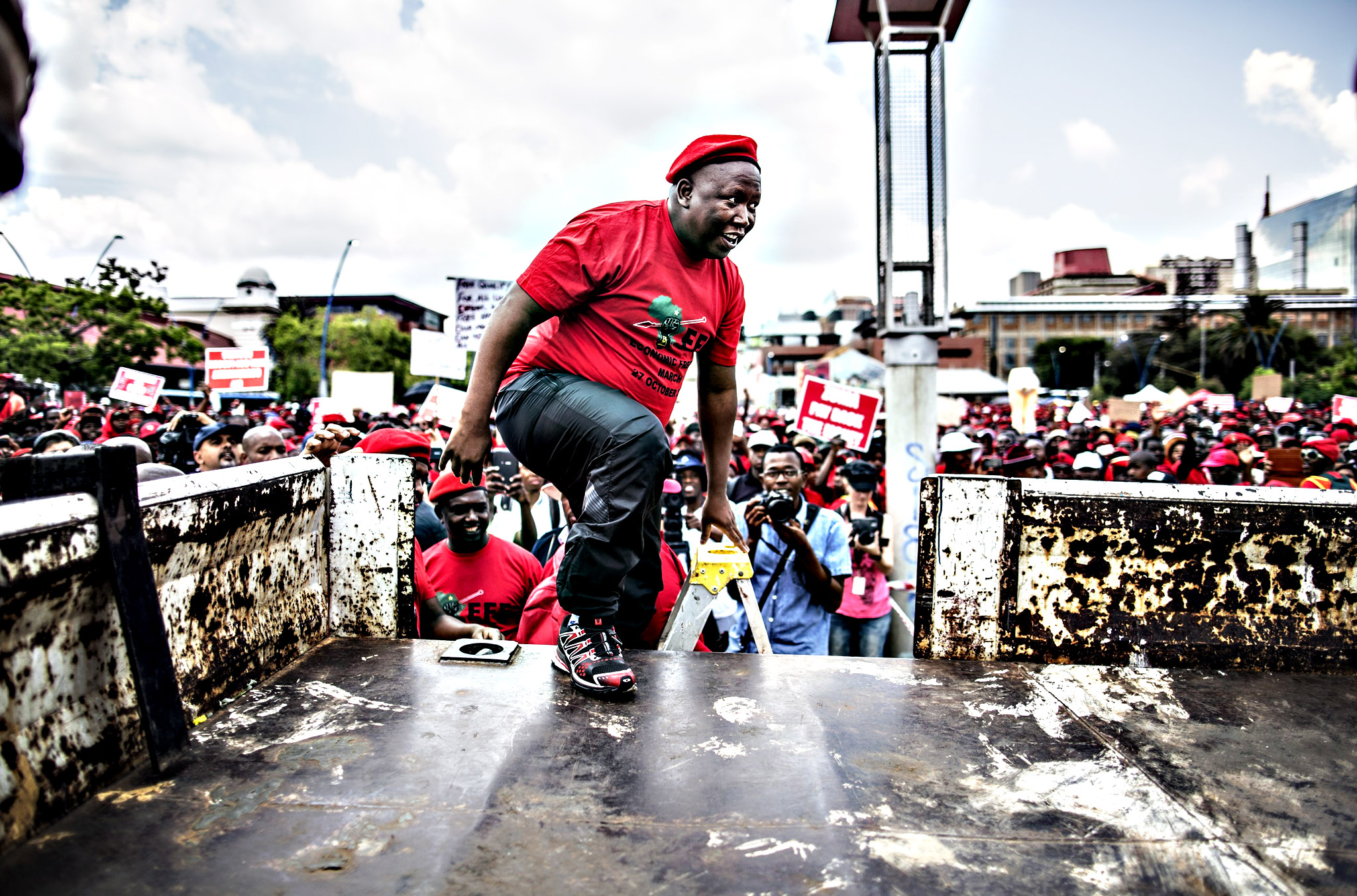 "South African opposition leader Julius Malema of the Economic Freedom Fighters (EFF) arrives on stage at the beginning of a march called for ""economic transformation"" in Johannesburg on Tuesday"