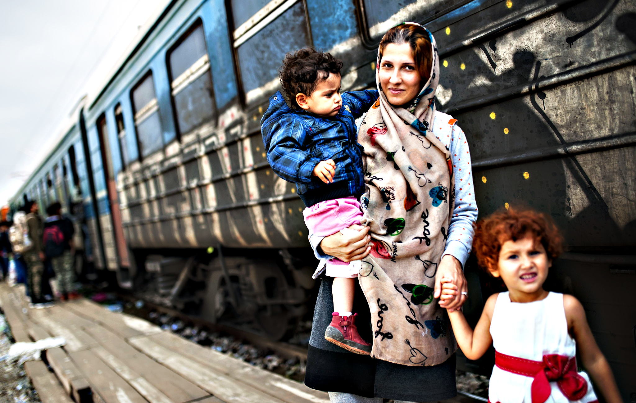 A migrant woman with her children board a train, after crossing the Greek-Macedonian border, near Gevgelija, on Friday.