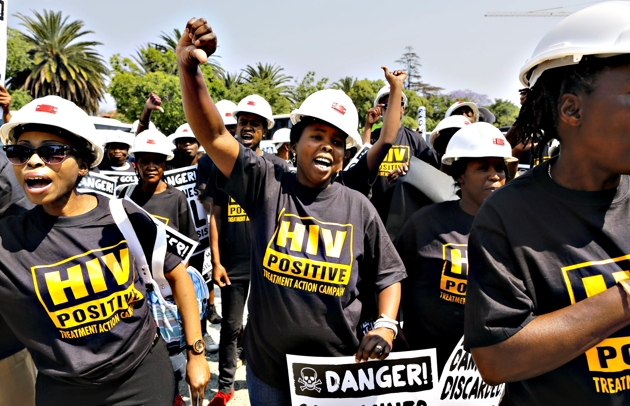 South Africa miners strike ...epa04975918 Protesters chant slogans during a protest to show their support to fellow miners who filed a lawsuit against mining companies, Johannesburg, South Africa, 13 October 2015. High Court in Johannesburg will begin on 13 October hearing in a lawsuit filed by 56 former mine workers who say they suffered silicosis, a lung disease caused by the inhalation of silica dust, due to their work at gold mines.