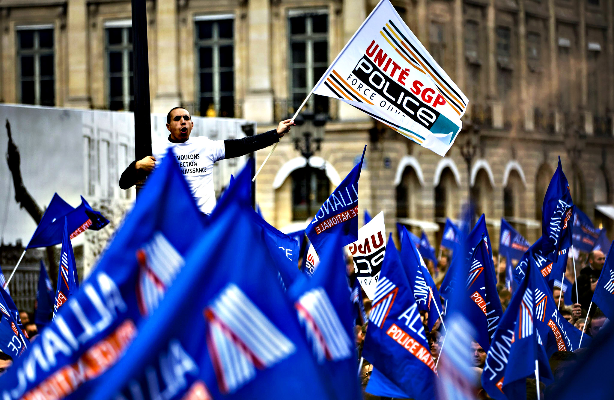 French police officers protest in front of the Ministry of Justice on Place Vendome, during a demonstration calling for more resources and improved security measures in their work environment, in Paris, France, 14 October 2015. The protest is organised just one week after a police officer was seriously wounded in a shoot-out with a gunman who was granted an out-of-jail permit.