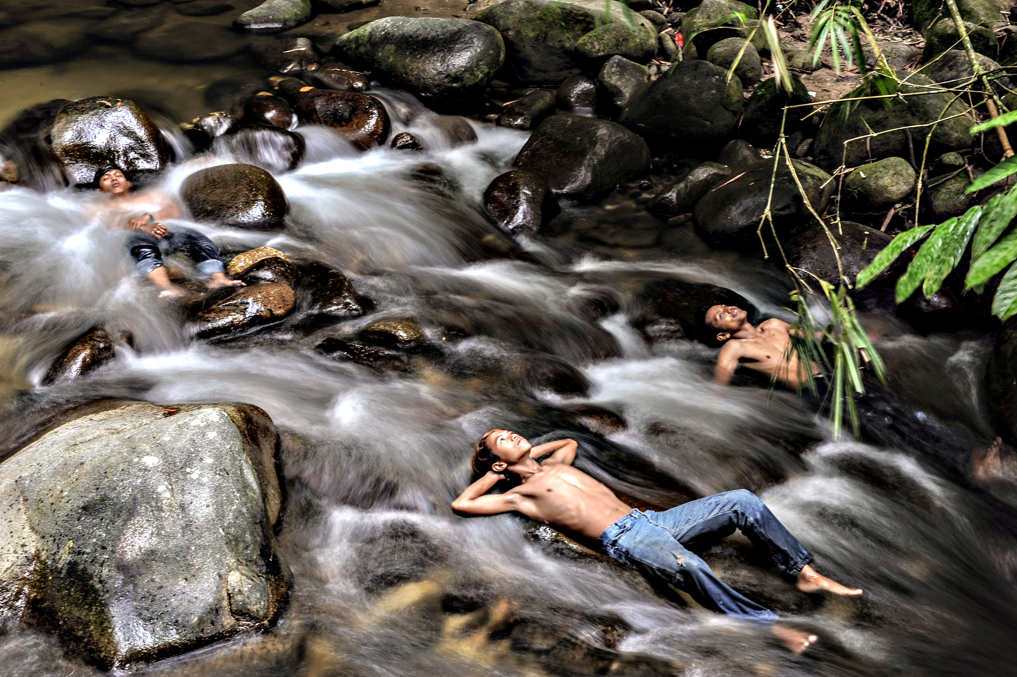 Malaysian youths cool off in a river as schools remain closed due to hazy conditions in Hulu Langat on Tuesday. Malaysia