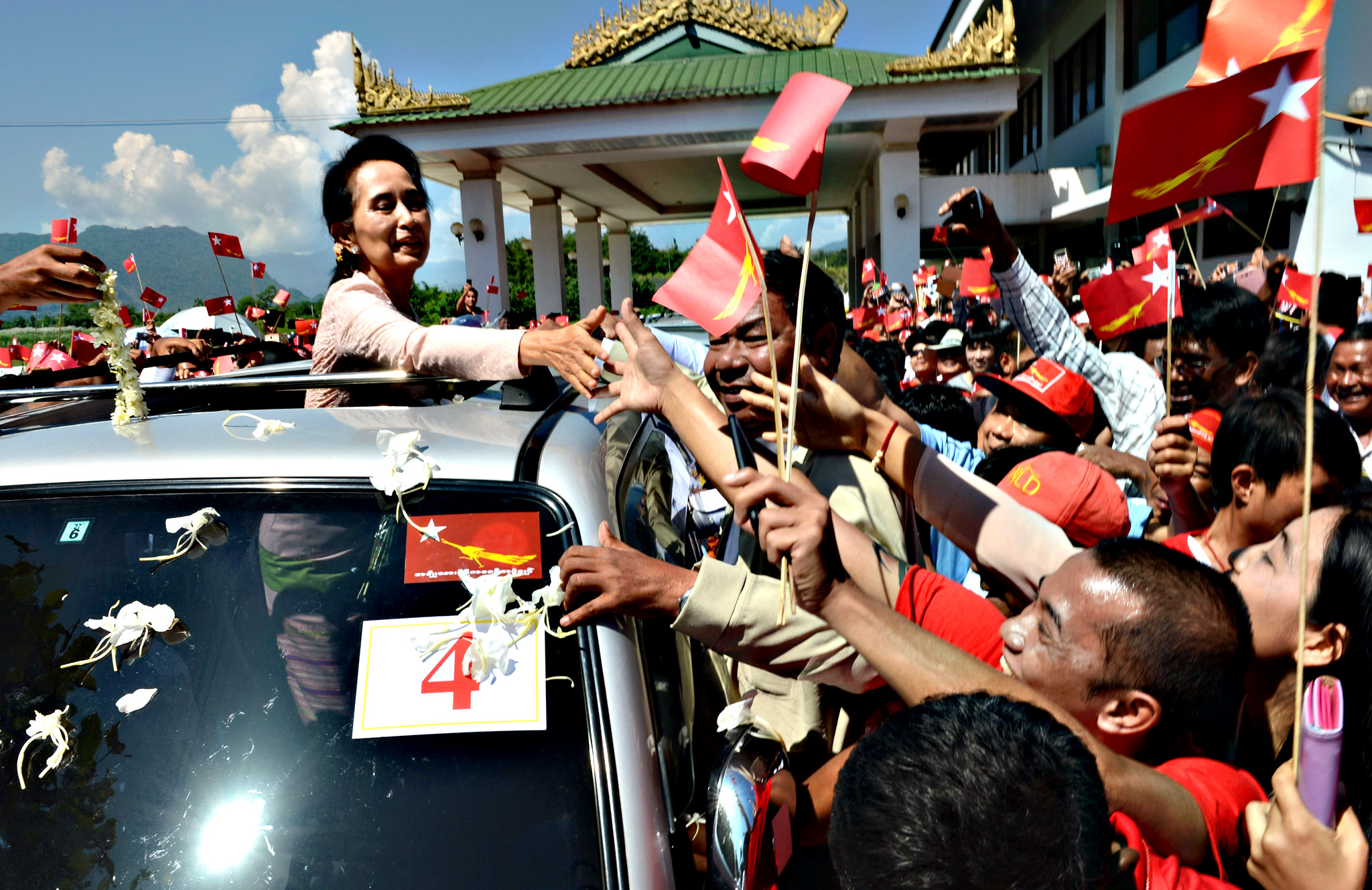 Myanmar opposition leader Aung San Suu Kyi  greets supporters and Shan ethnic minorities on arrival at Tachileik airport in Shan State to campaign for National League for Democracy (NLD) on October 21, 2015.  European Union observers will be given access to voting on military bases for next month's Myanmar election, an official said, a move to bolster oversight of a poll billed as the country's fairest in decades.