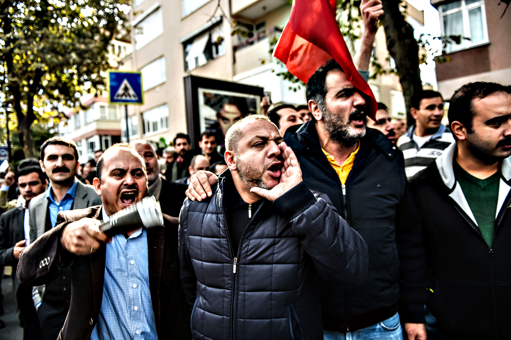 Supporters of Bugun and Kanalturk media groups shout slogans towards Turkish riot police onTuesday in Istanbul. Turkish police swooped on the Ankara-based offices of a media groups critical of President Recep Tayyip Erdogan, a day after two British reporters were jailed on controversial terror charges.The raids on Koza-Ipek Media sparked fresh concern about press freedom in Turkey, which is gearing for snap legislative elections in November, its second in five months.