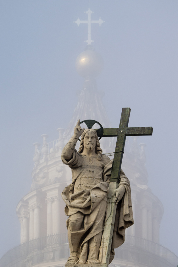 Fog partially covers the Cupola of St. Peter's Basilica, fronted by a statue of Jesus, prior to the arrival of Pope Francis for his weekly general audience, Wednesday, Nov. 11, 2015. (AP Photo/Andrew Medichini)