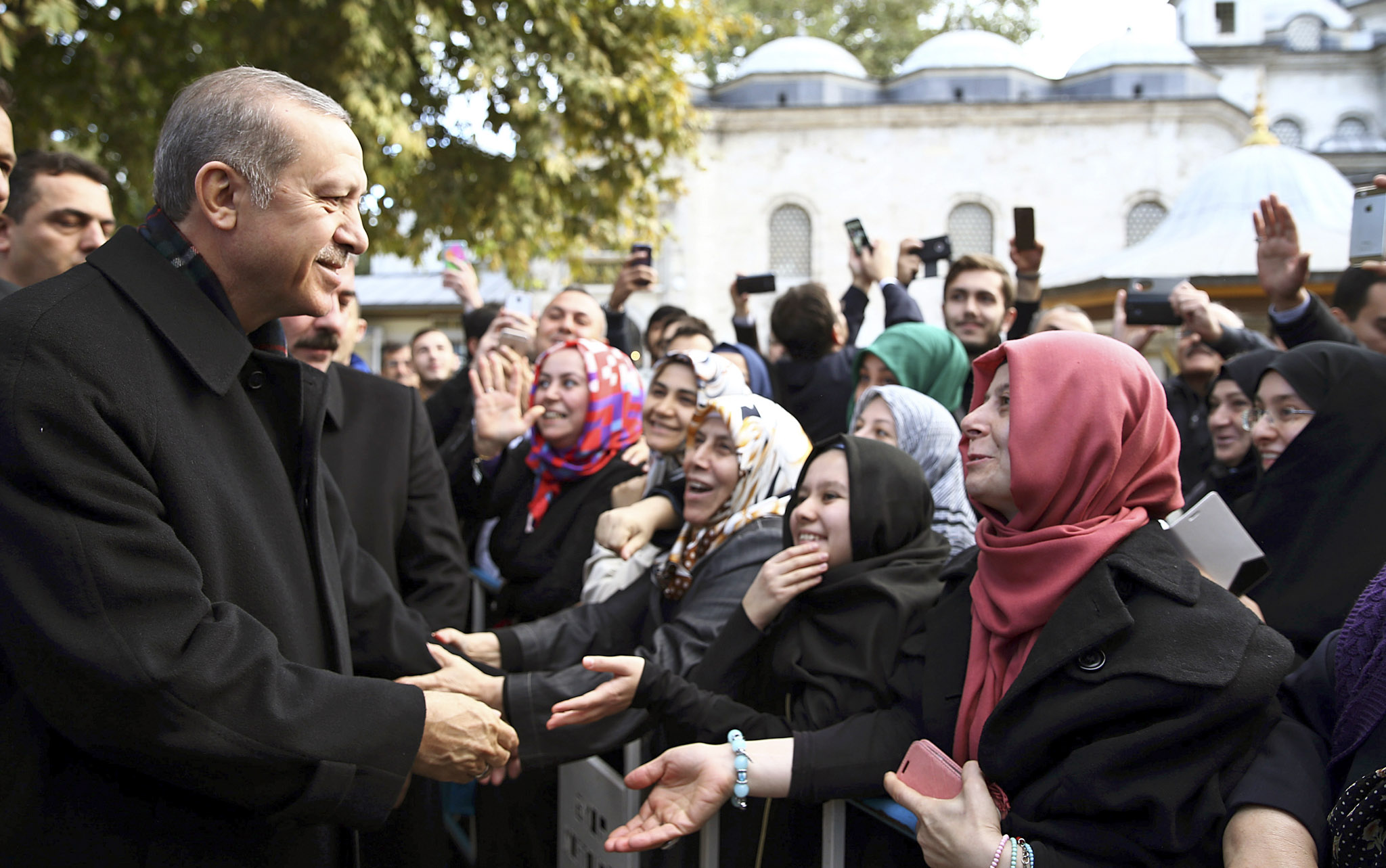Recep Tayyip Erdogan...Turkey's President Recep Tayyip Erdogan, left, speaks to supporters after morning prayers at Eyup Sultan Mosque in Istanbul, Turkey, Monday, Nov. 2, 2015. Erdgoan hailed a big victory for his ruling party in parliamentary elections and called on the world to respect it. The ruling Justice and Development party, or AKP, won more than 49 percent of the vote in the snap election, almost double that of the next party in Sundayís vote. The win restored the single-party majority that it had lost in June elections. (Presidential Press Service/Pool Photo via AP)