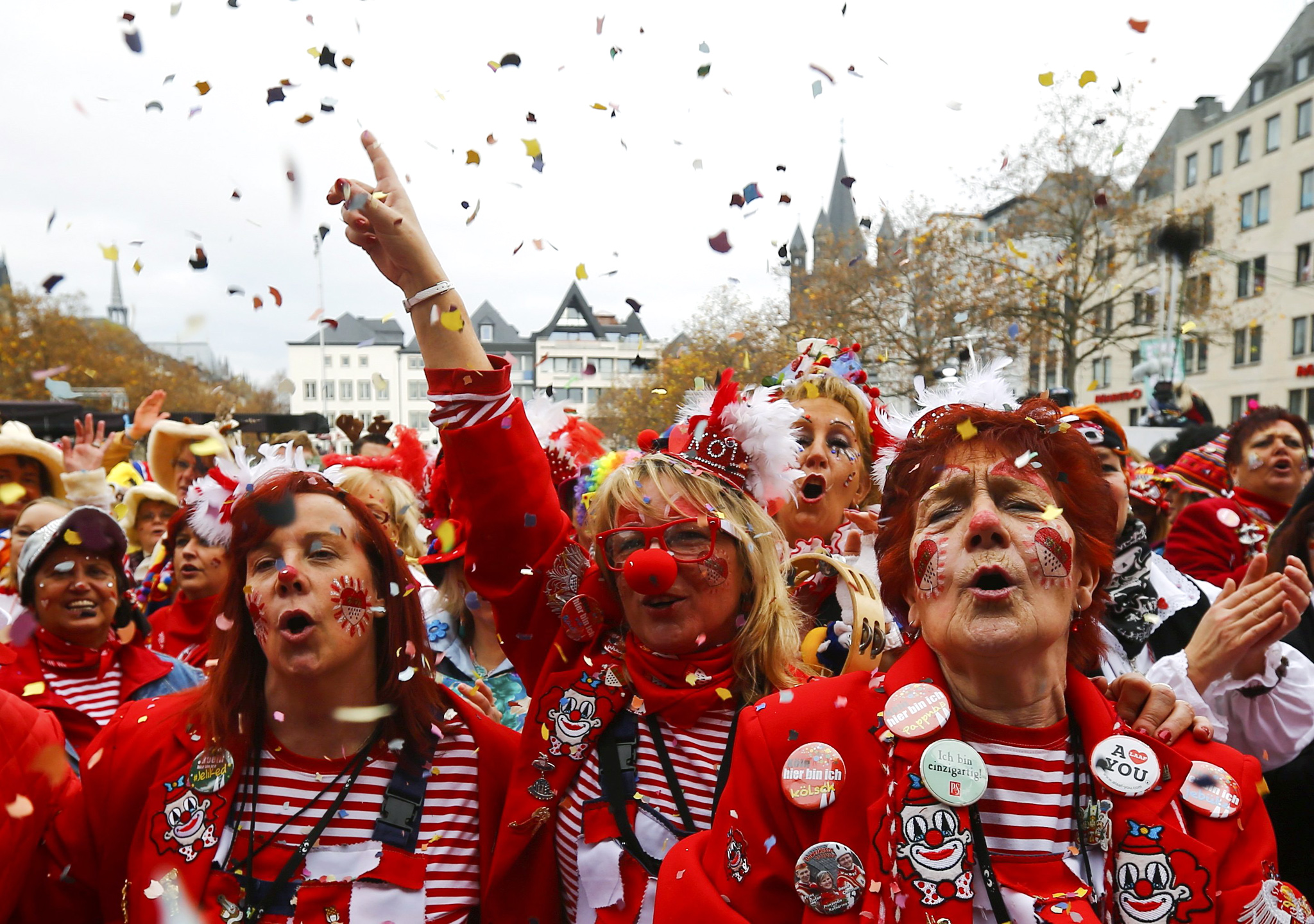 Carnival revellers celebrate the start of the carnival season in Cologne...Carnival revellers throw confetti as they celebrate the start of the carnival season in Cologne November 11, 2015. In many parts of Germany, at 11:11am on November 11, people mark the official start of carnival, a season of controlled raucous fun that reaches a climax during the days before Ash Wednesday and the start of Lent.      REUTERS/Wolfgang Rattay