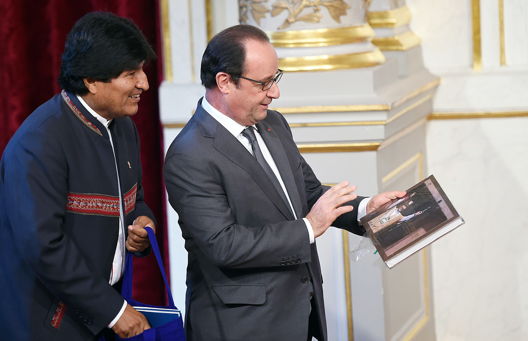 Bolivian President Evo Morales (L) offer...Bolivian President Evo Morales (L) offers a book to French President Francois Hollande after a joint press conference on November 9, 2015 at the Elysee Presidential Palace in Paris. AFP PHOTO / STEPHANE DE SAKUTINSTEPHANE DE SAKUTIN/AFP/Getty Images