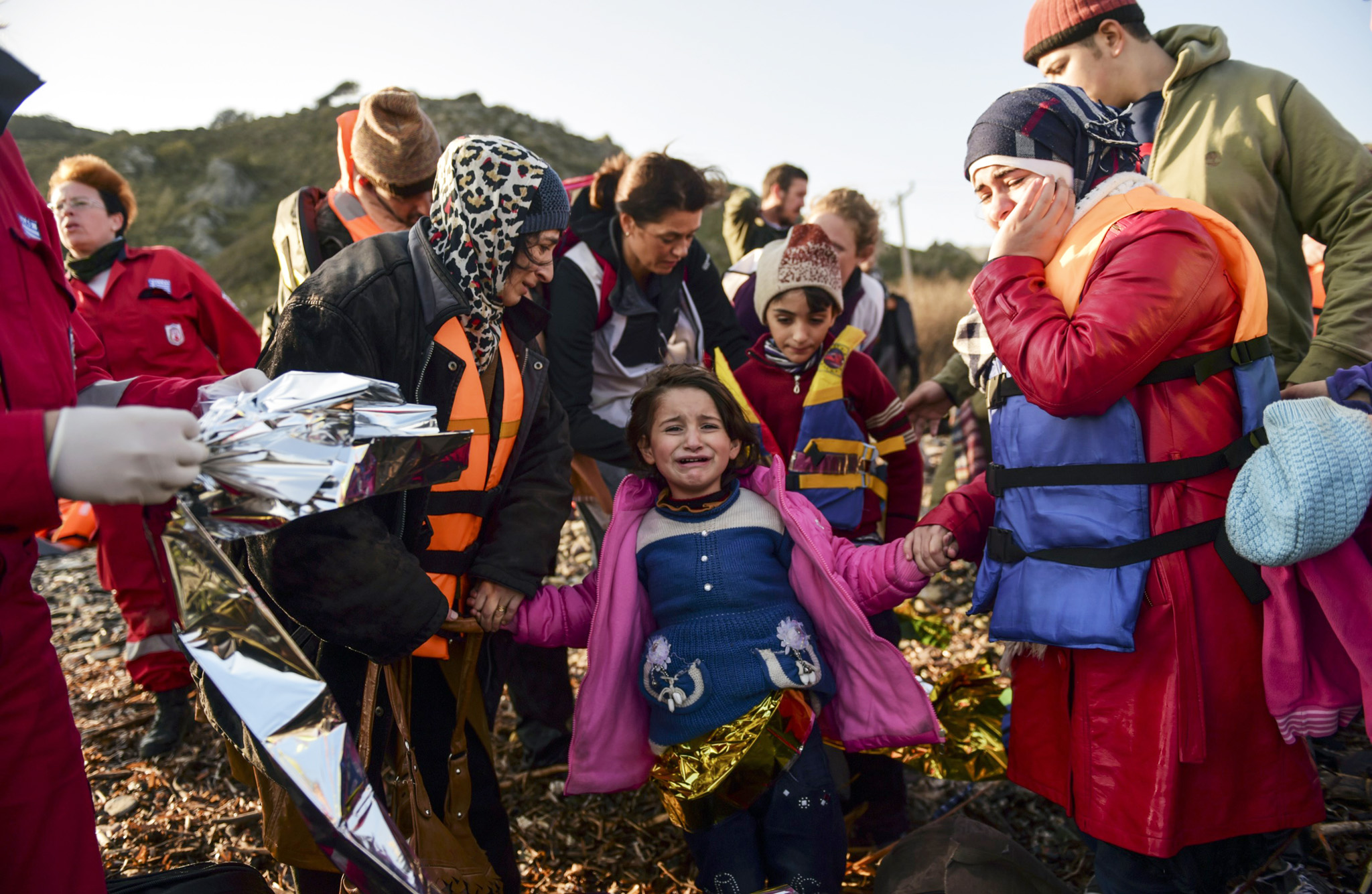 Migrants and refugees receive help after...Migrants and refugees receive help after their arrival on the Greek island of Lesbos after crossing the Aegean Sea from Turkey on November 17, 2015. European leaders tried to focus on joint action with Africa to tackle the migration crisis, as Slovenia became the latest EU member to act on its own by barricading its border. AFP PHOTO/BULENT KILICBULENT KILIC/AFP/Getty Images