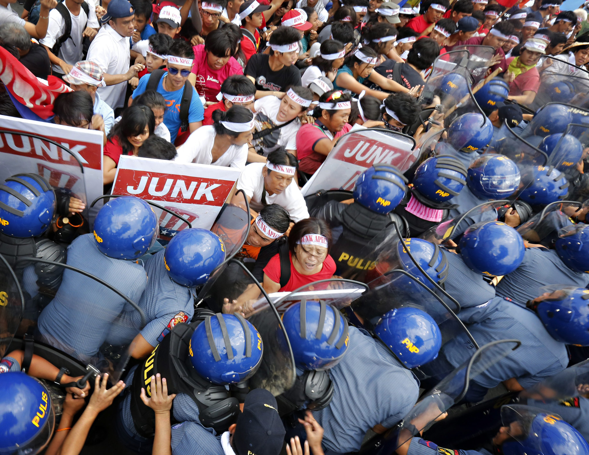Filipino activists clash with riot police officers during a protest rally near the venue of the on-going Asia-Pacific Economic Cooperation (APEC) summit in Manila